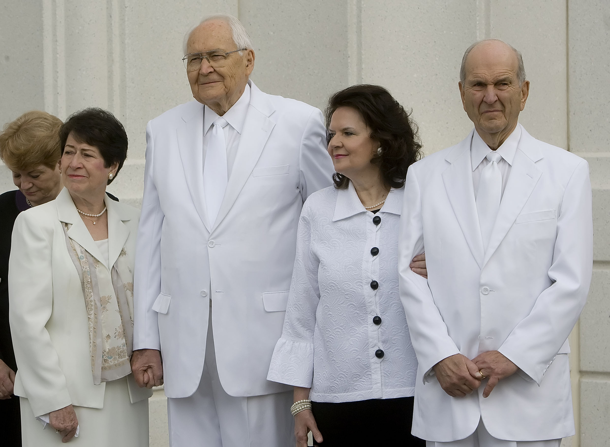 Elder L. Tom Perry of the Quorum of the Twelve Apostles and wife Sister Barbara Perry, left, stand with Elder Russell M. Nelson of the Quorum of the Twelve Apostles and his wife, Wendy Watson Nelson for the cornerstone ceremony. About 200 took part in the ceremony at the Brigham City Temple prior to the dedication Sunday, Sept. 23, 2012.