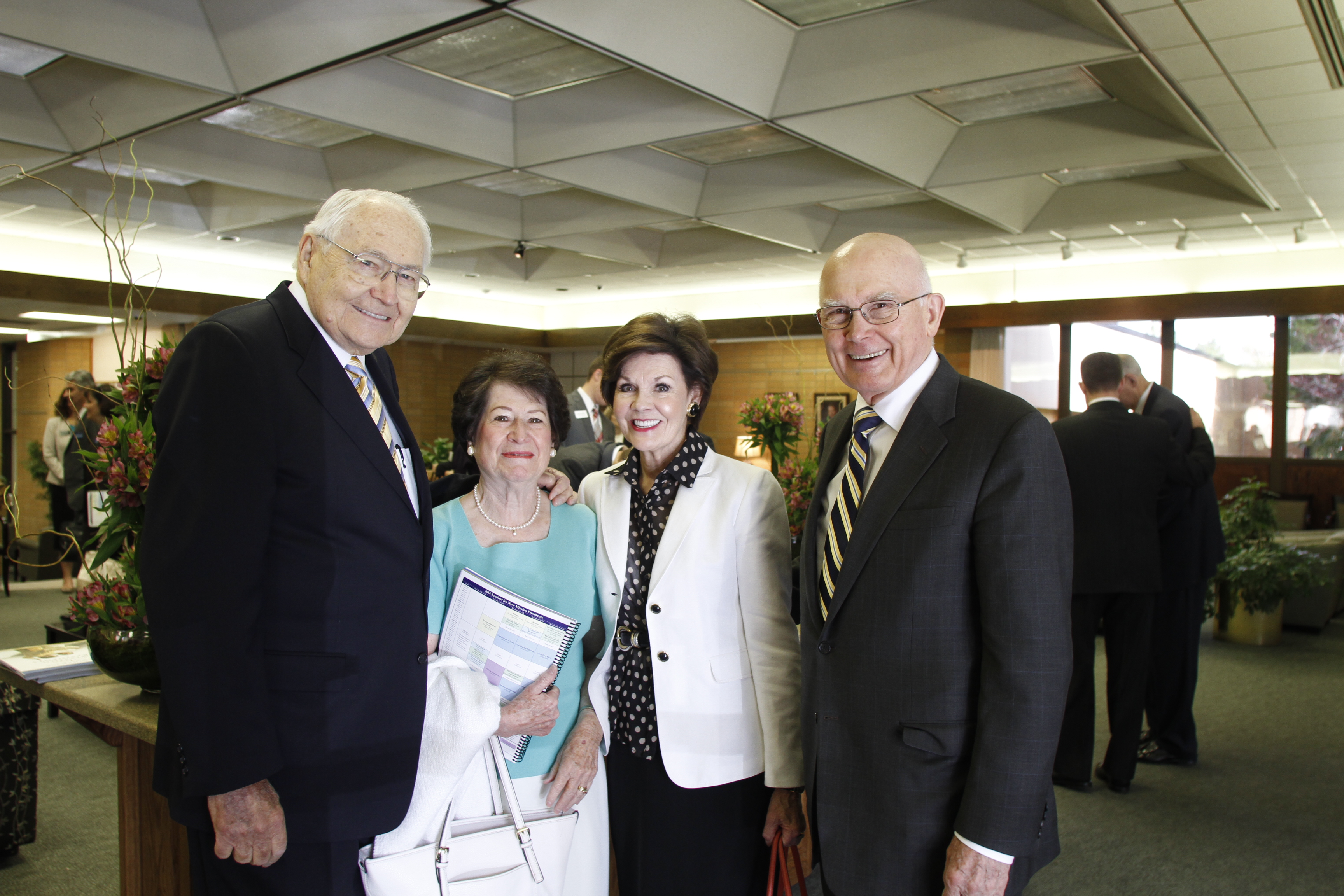 Elder L. Tom Perry, Sister Barbara Perry, Sister Kristen Oaks and Elder Dallin H. Oaks pose for a photo during the 2014 Seminar for New Mission Presidents at the Missionary Training Center in Provo, Utah.