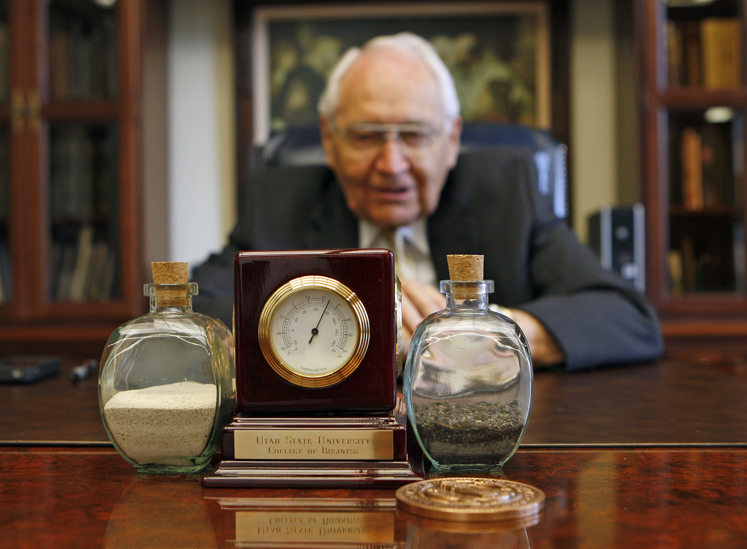 Elder L. Tom Perry at his desk where he keeps some sand from Saipan, left, and coral from Iwo Jima, Tuesday, July 31, 2012, in Salt Lake City, Utah.
