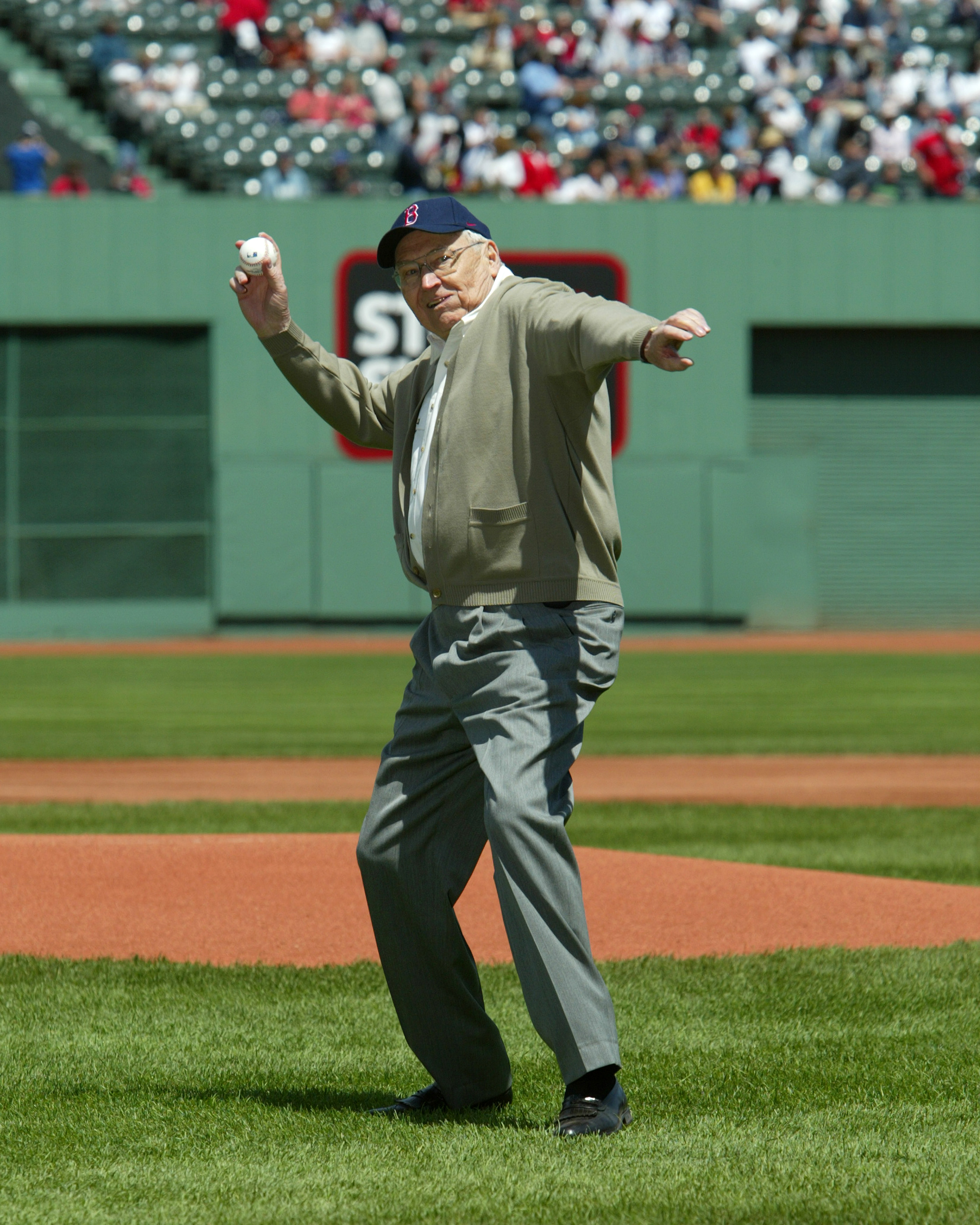 Elder L. Tom Perry winds up to throw the ceremonial first pitch prior to a Boston Red Sox baseball game on May 8, 2004.