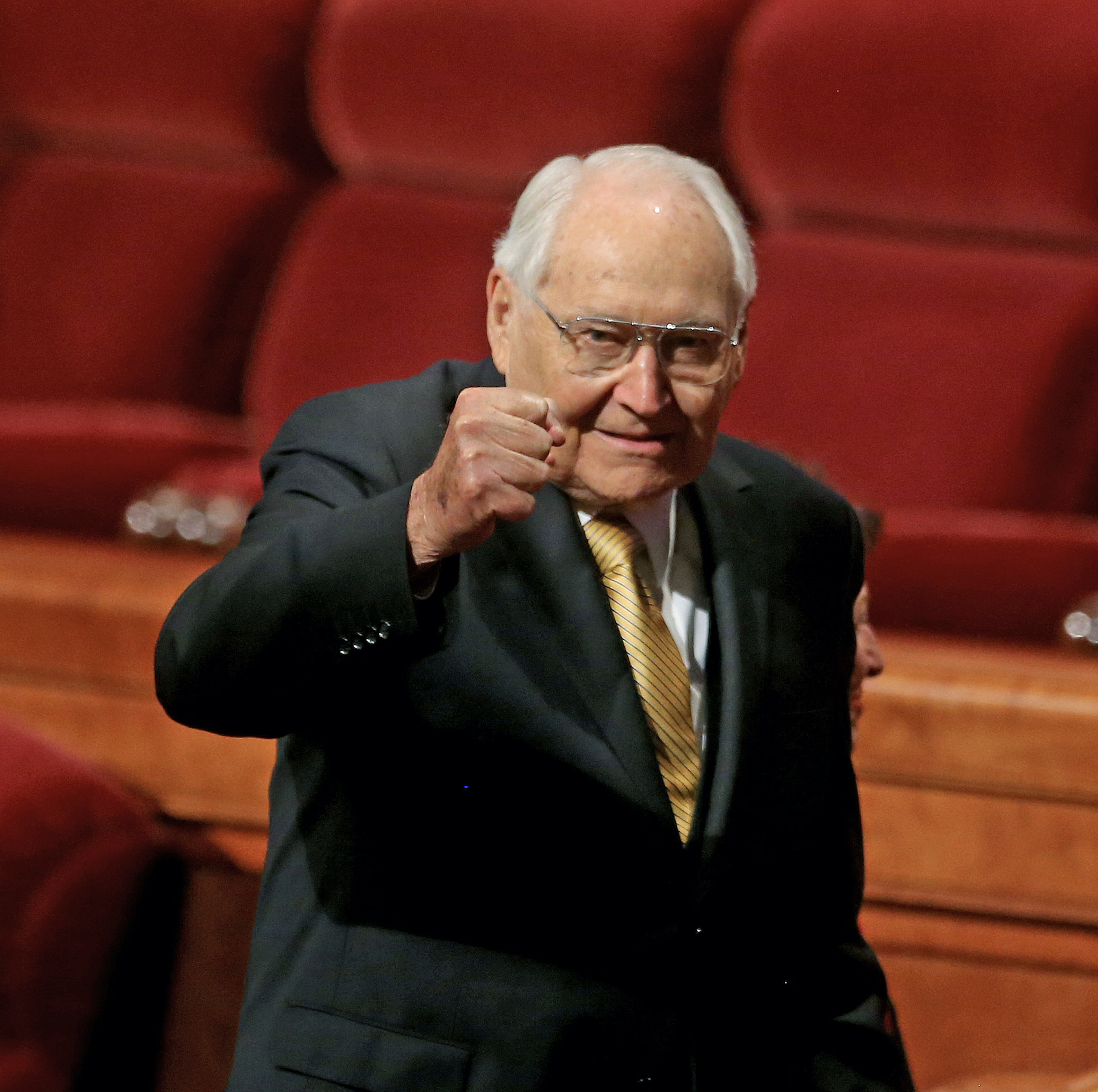 Elder L. Tom Perry of the Quorum of the Twelve Apostles pumps his fist.