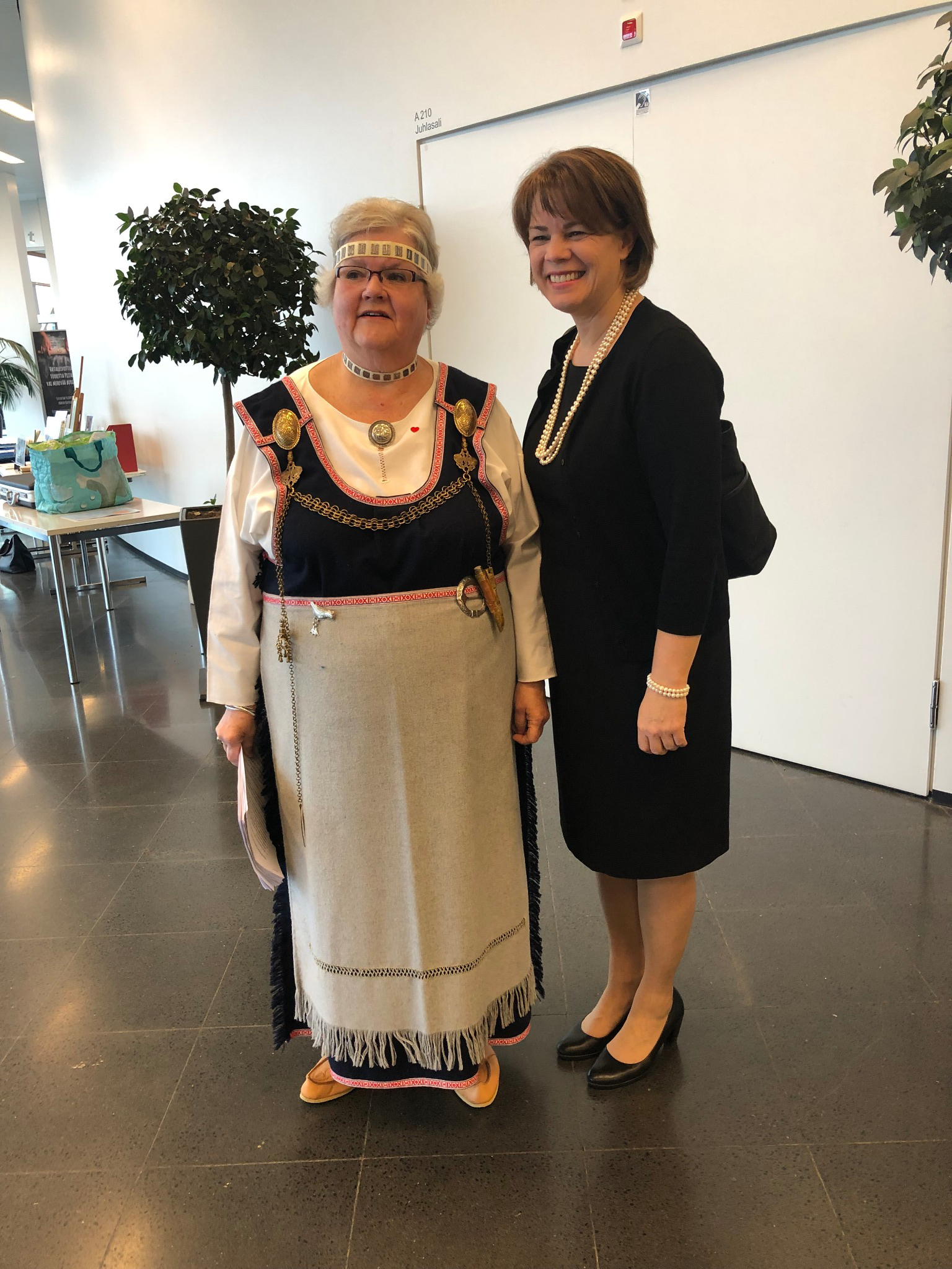 Sister Sharon Eubank visits with a woman in traditional Finnish dress at a women's conference in Tampere, Finland, Saturday, September 21, 2019.