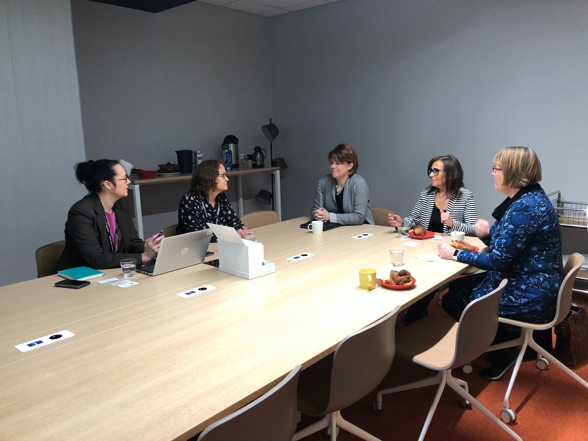 Sister Sharon Eubank, president of Latter-day Saint Charities (center), visits with leaders of the Finnish Refugee Council in Helsinki, Finland, Friday, September 20, 2019.