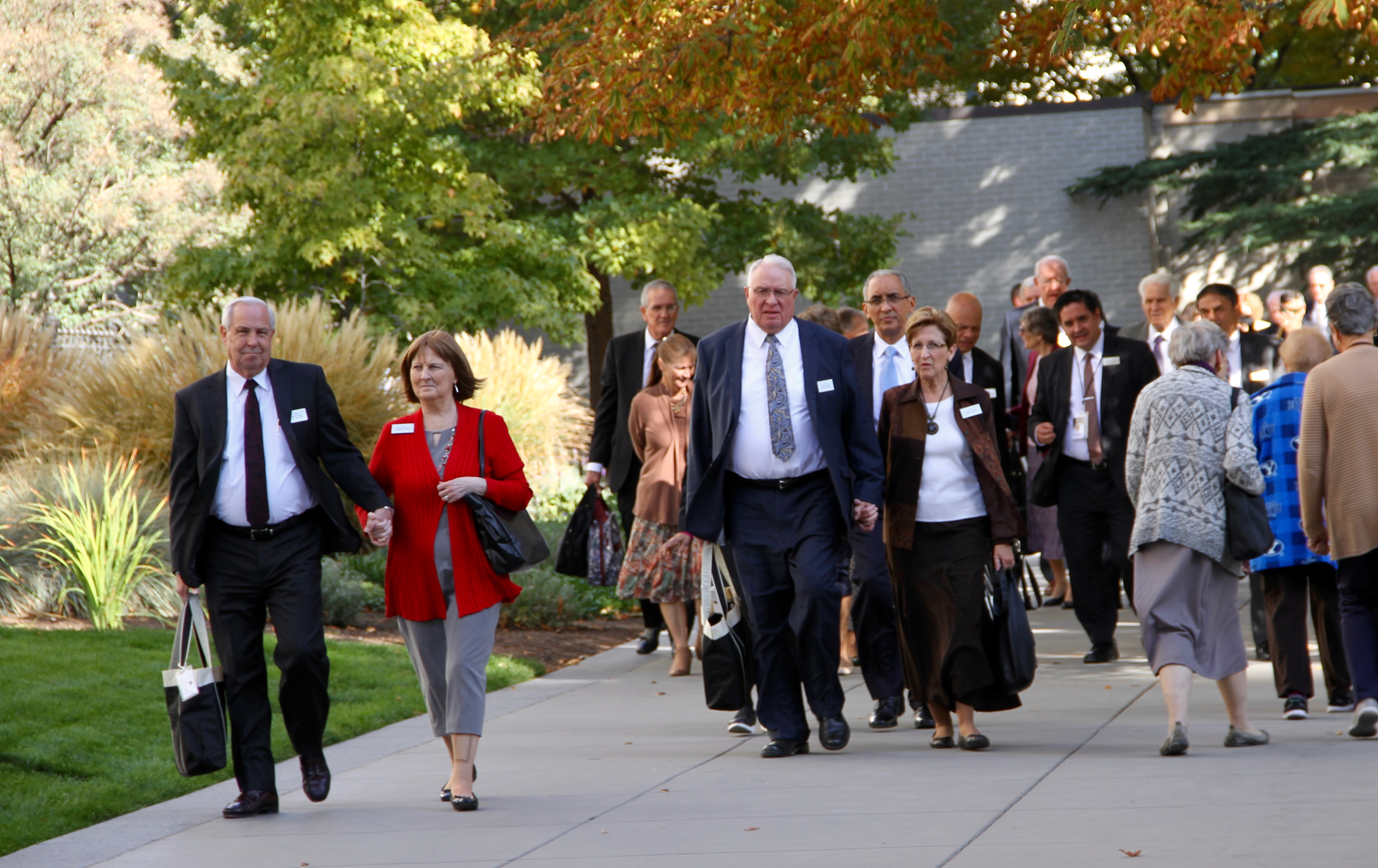 Recently called temple presidents and temple matrons attending the 2019 Temple Leadership Seminar walk through Temple Square on Tuesday, Oct. 15, 2019, in Salt Lake City.