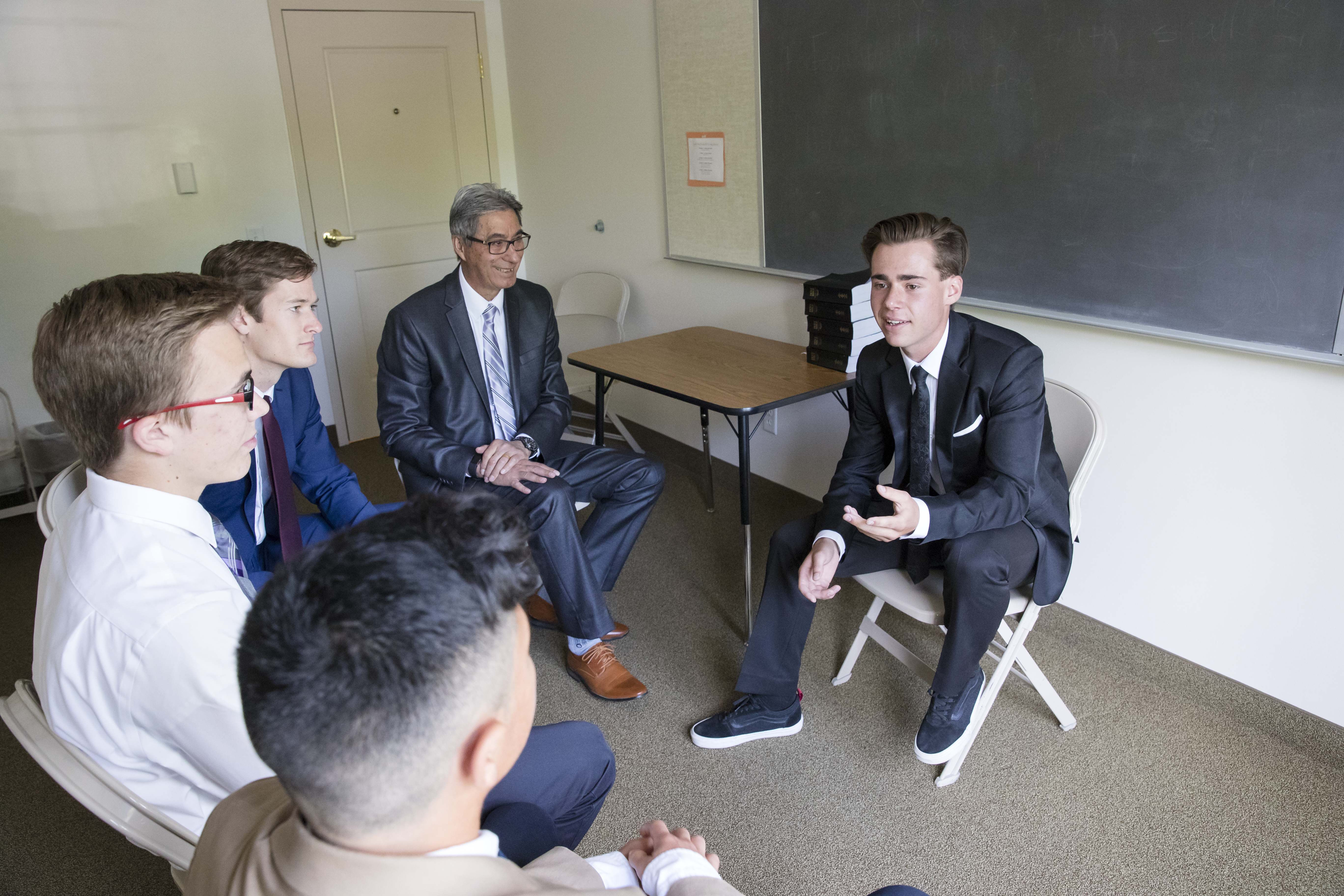 "Young men have a discussion during a quorum meeting on Sunday. Starting in January, ""Come, Follow Me"" for Aaronic Priesthood and Young Women will give more responsibility to quorum and class presidencies."