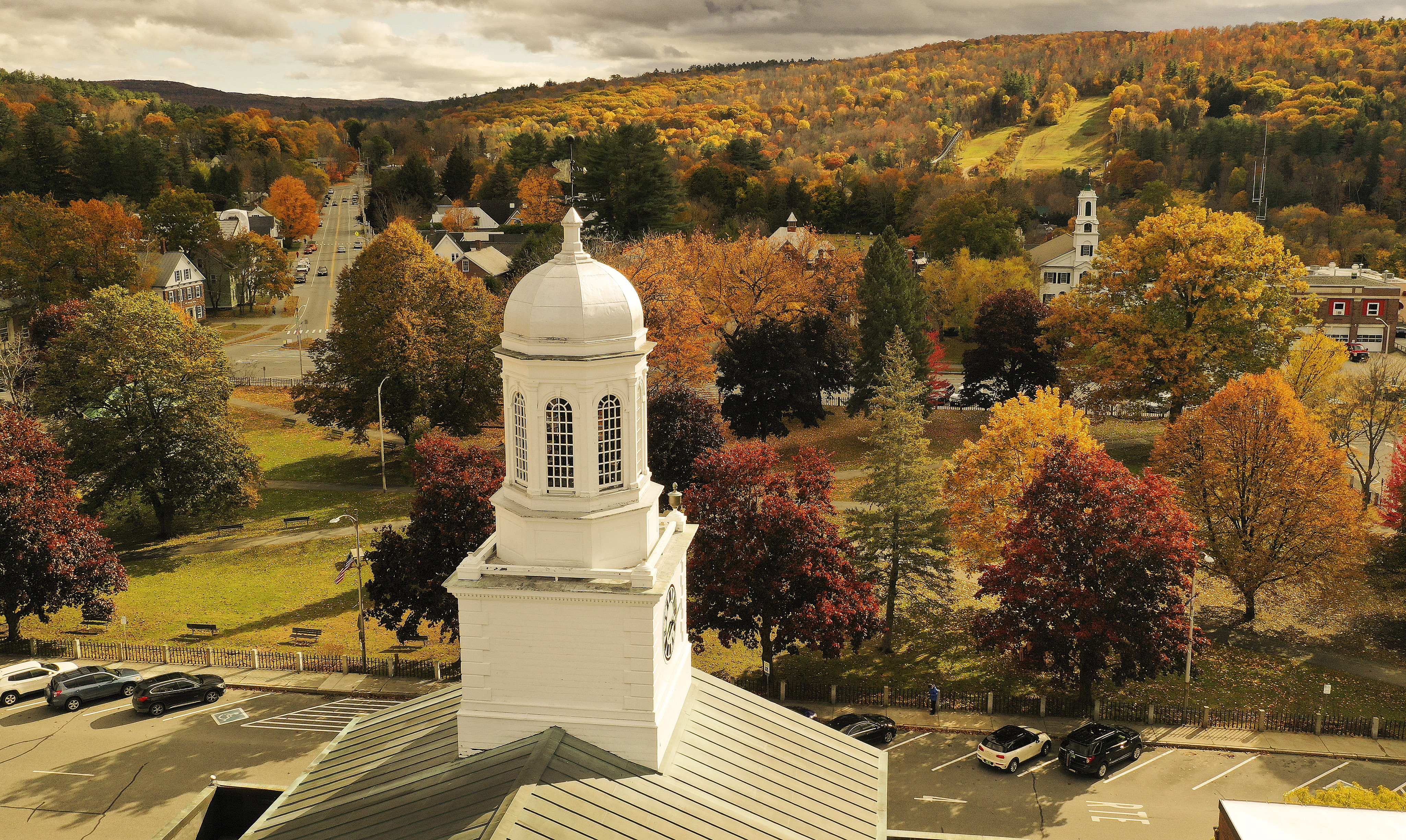 City Hall in Lebanon, New Hampshire is surrounded by Fall colors on Friday, Oct. 18, 2019.