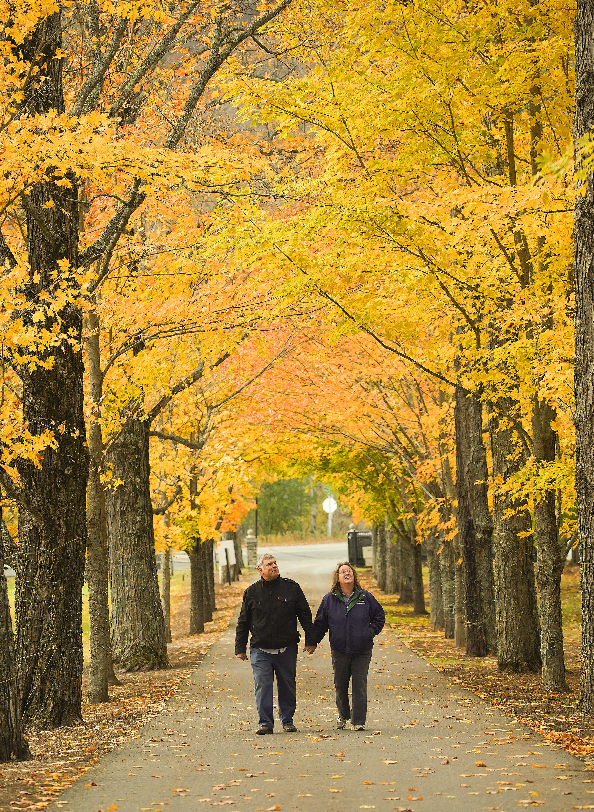 Missionaries Larry and Cathy McKnight walk in the Fall colors near Sharon, Vermont on Friday, Oct. 18, 2019.