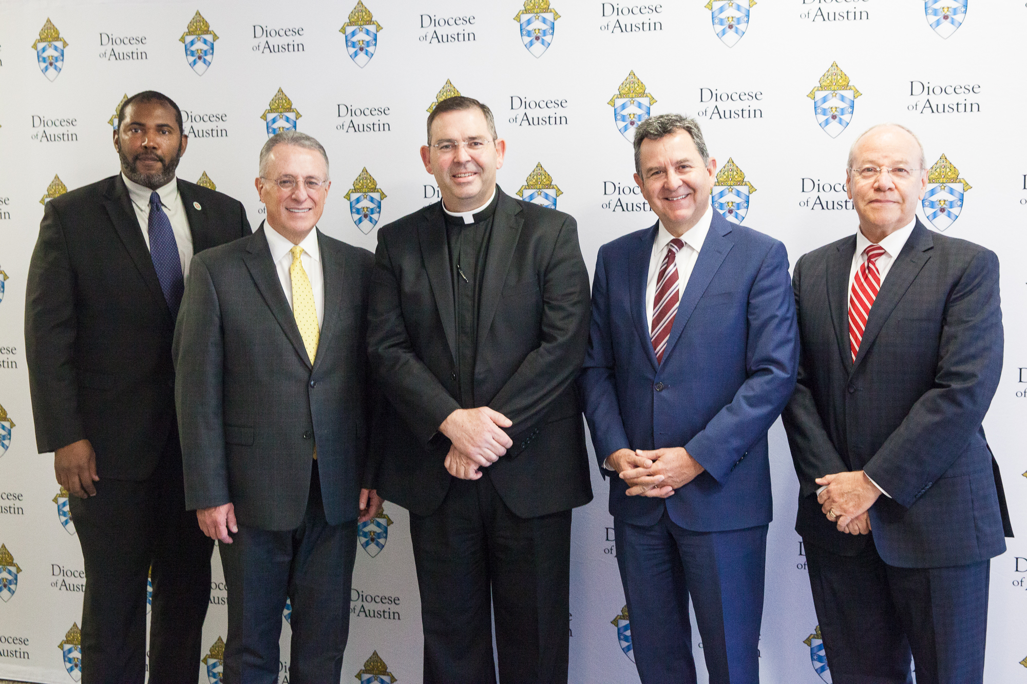 From left to right: Father DeKarlos Blackmon, secretariat director of the Diocese of Austin; Elder Ulisses Soares; Father James Misko, vicar general of the Diocese of Austin; Elder Adrian Ochoa; and Elder Carlos Villareal at the Diocese of Austin on Oct. 18, 2019.