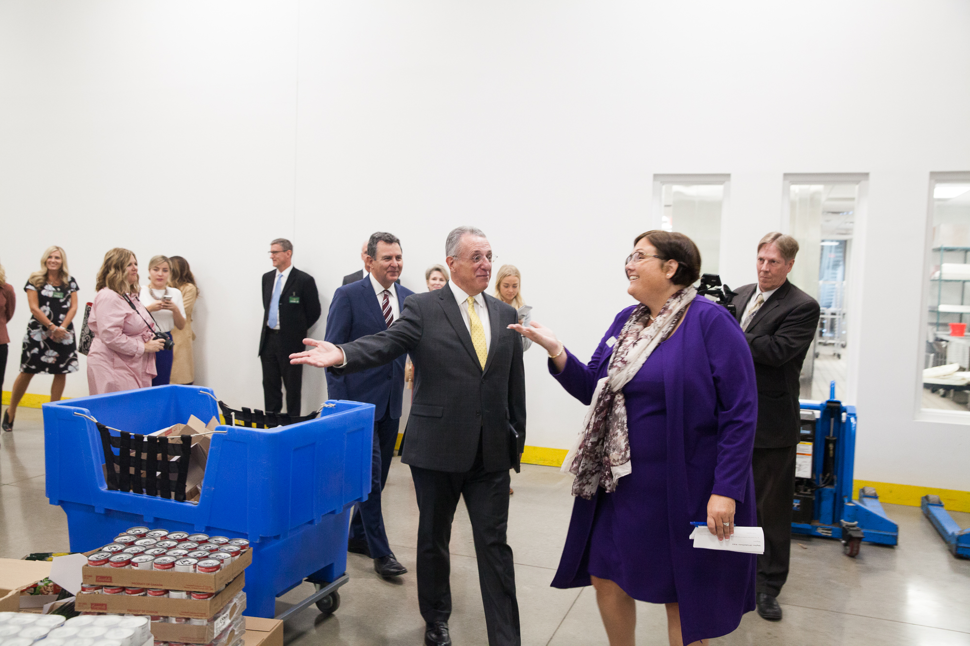 Elder Ulisses Soares is given a tour by Denise Blok, chief operating officer of the Central Texas Food Bank during a visit to their facilities on Oct. 18, 2019.