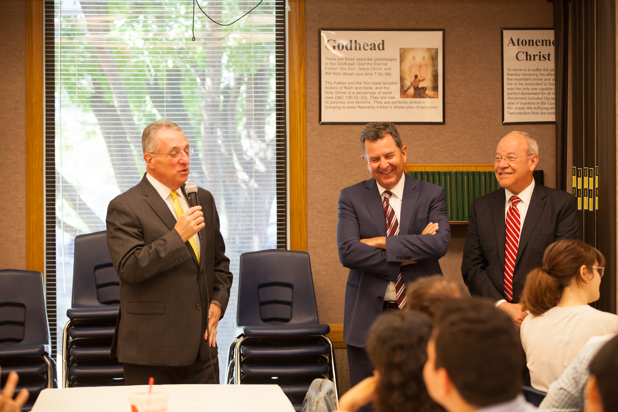 Elder Ulisses Soares, joined by Elder Adrian Ochoa, left, and Elder Carlos Villareal, speak to students at the Institute at the University of Texas at Austin on Oct. 18, 2019.