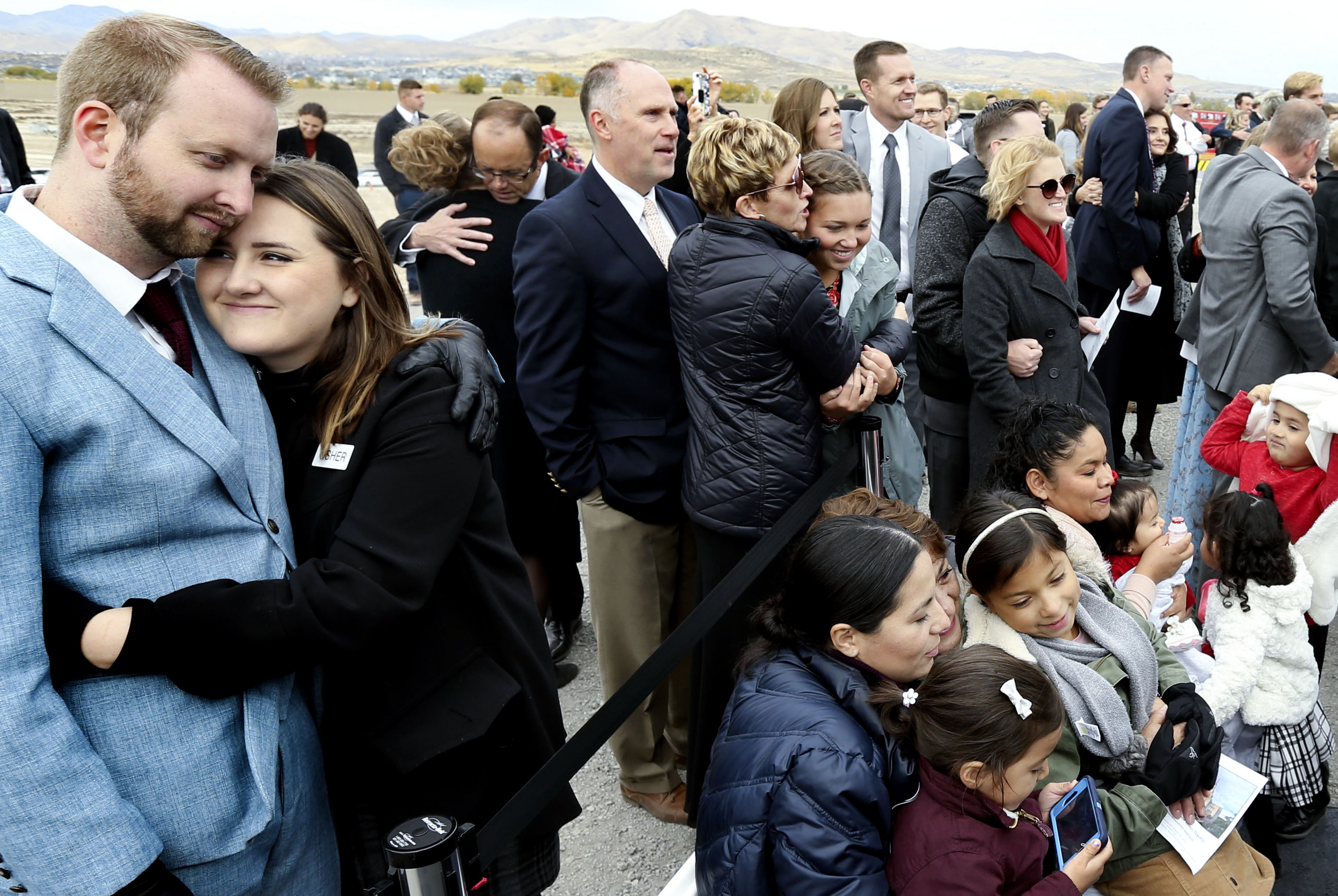 Elder Craig C. Christensen, president of the Utah Area, encourages the crowd to hug for warmth during the groundbreaking ceremony for the Saratoga Springs Utah Temple on Saturday, Oct. 19, 2019.