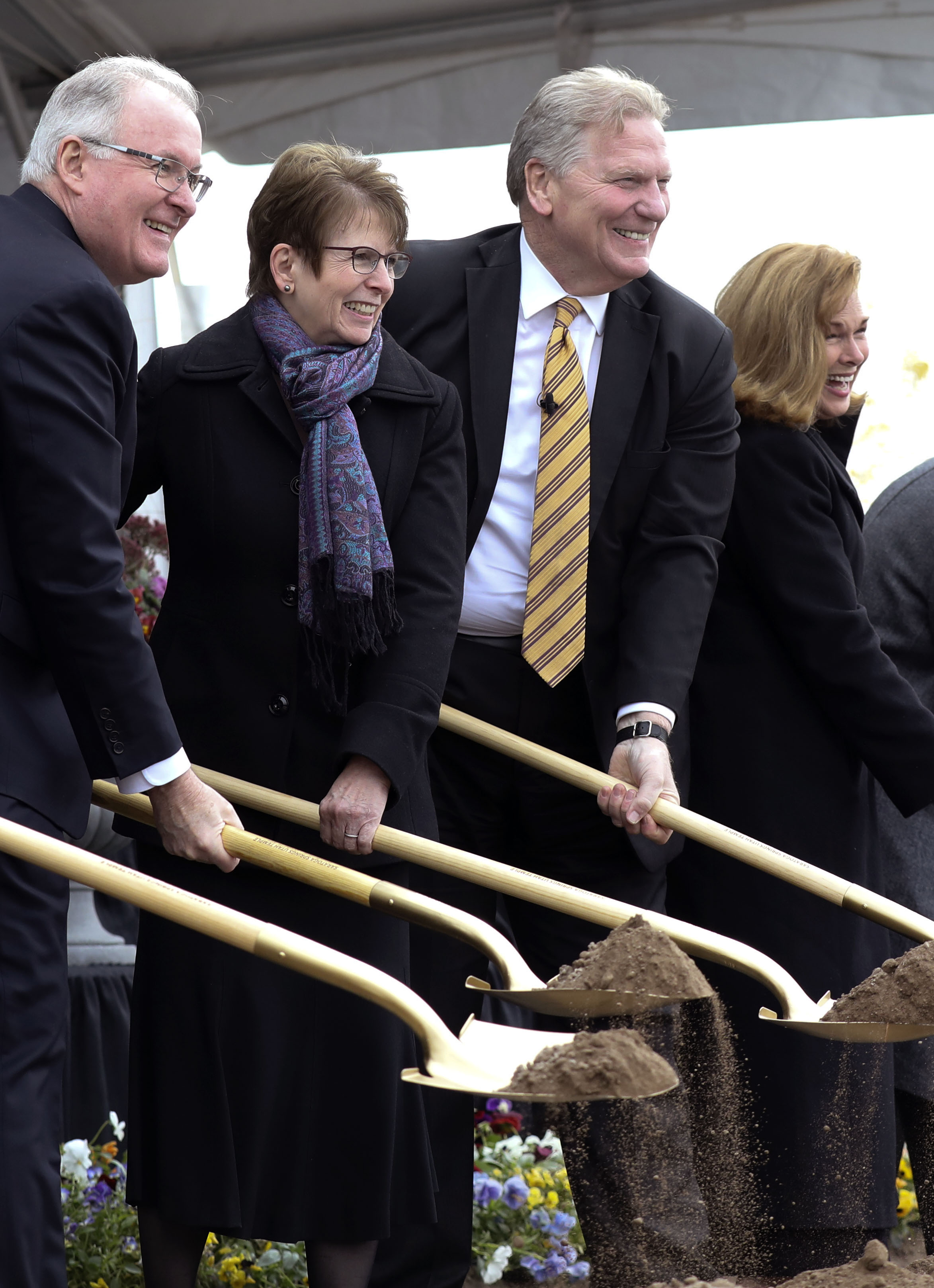 Elder Randy D. Funk, his wife Andrea, Elder Craig C. Christensen, president of the Utah Area, and his wife Debbie, throw dirt during the groundbreaking ceremony for the Saratoga Springs Utah Temple on Saturday, Oct. 19, 2019.