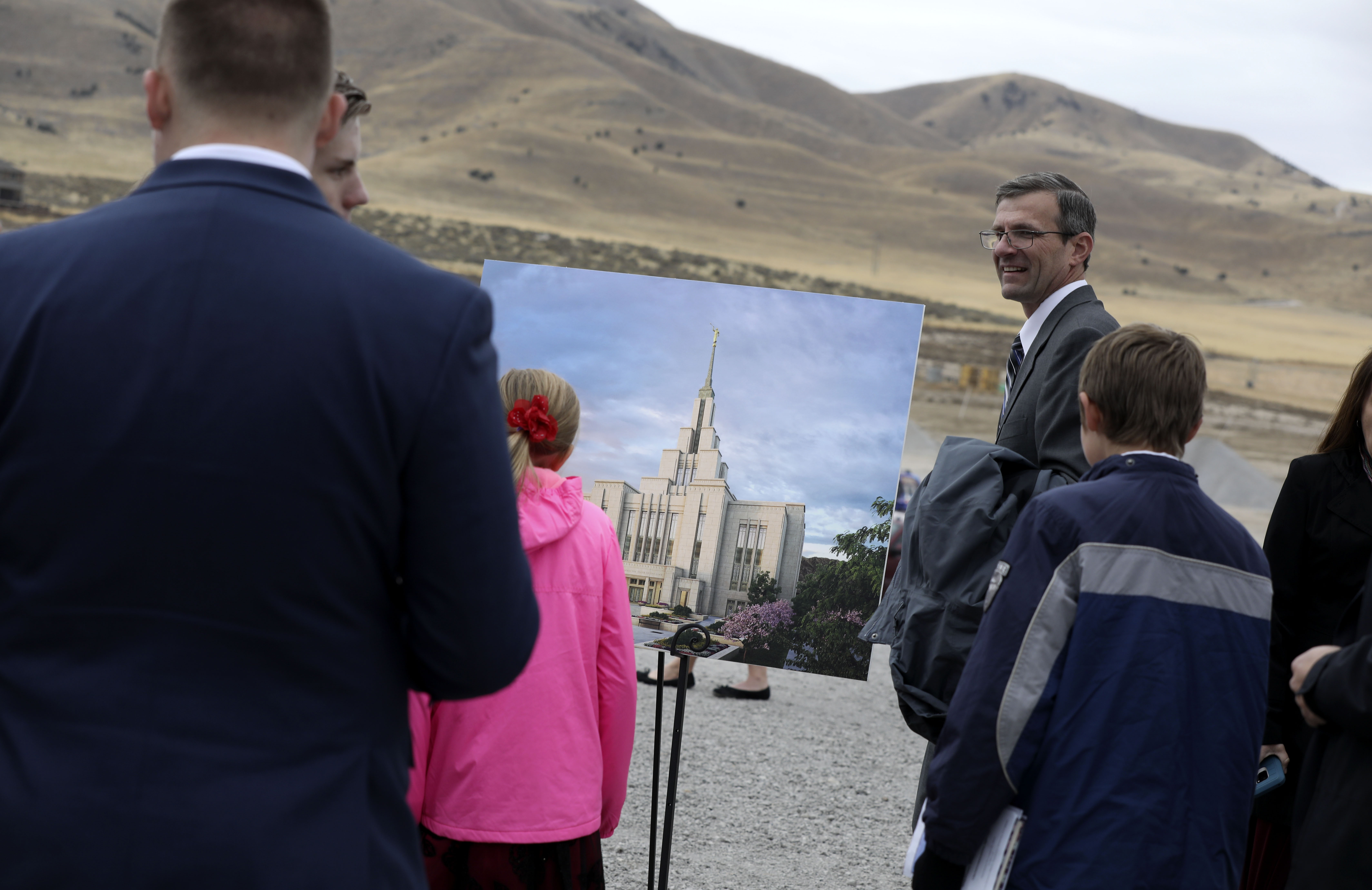 Latter-day Saints looks at a depiction of the future Saratoga Springs Utah Temple during the groundbreaking ceremony on Saturday, Oct. 19, 2019.