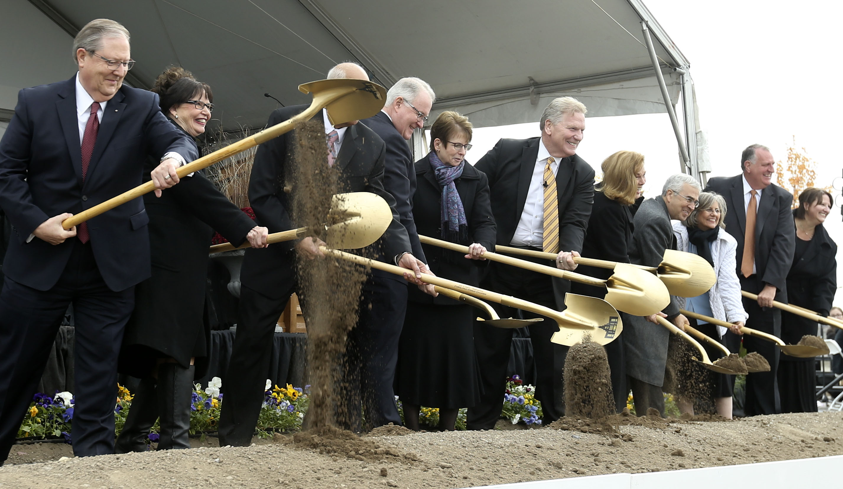 Dirt is tossed during the groundbreaking ceremony for the Saratoga Springs Utah Temple on Saturday, Oct. 19, 2019.