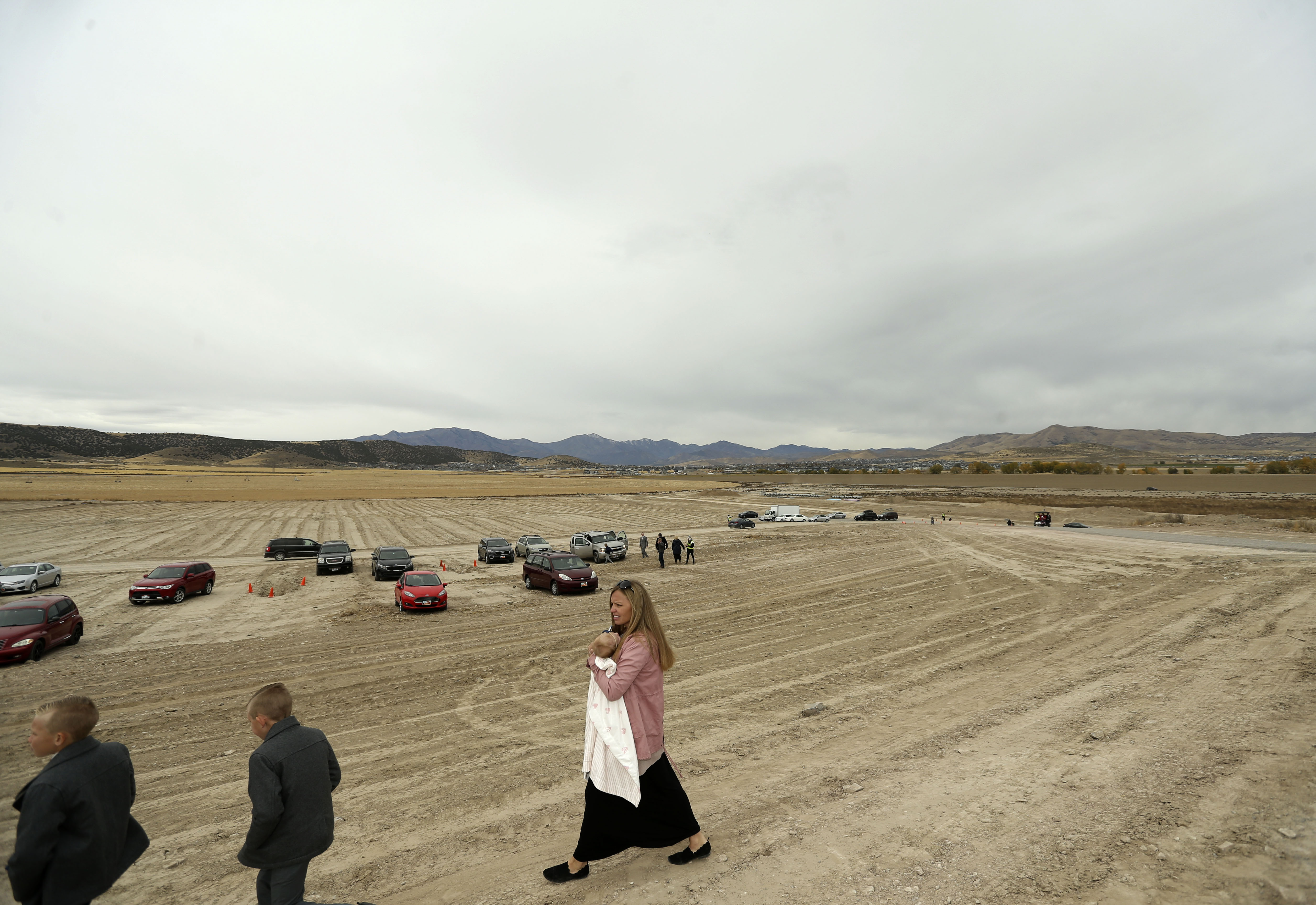 Latter-day Saints leave the groundbreaking ceremony for the Saratoga Springs Utah Temple on Saturday, Oct. 19, 2019.