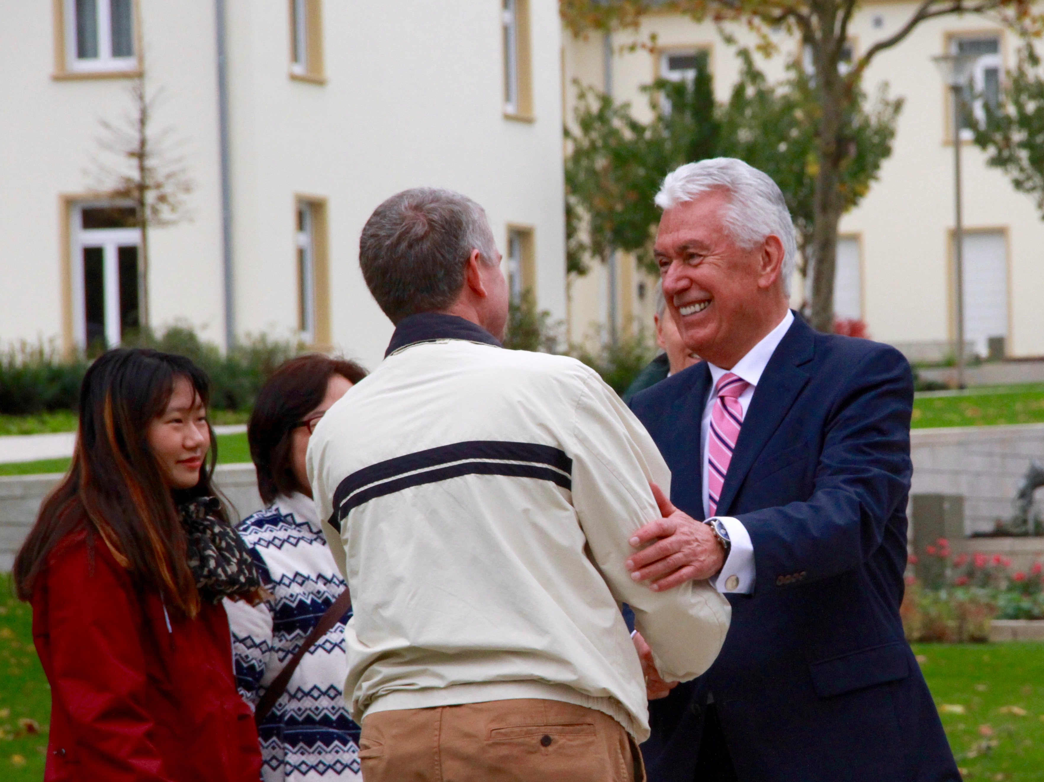 Elder Dieter F. Uchtdorf greets visitors to the Frankfurt Germany Temple grounds on Saturday, Oct. 19, 2019.