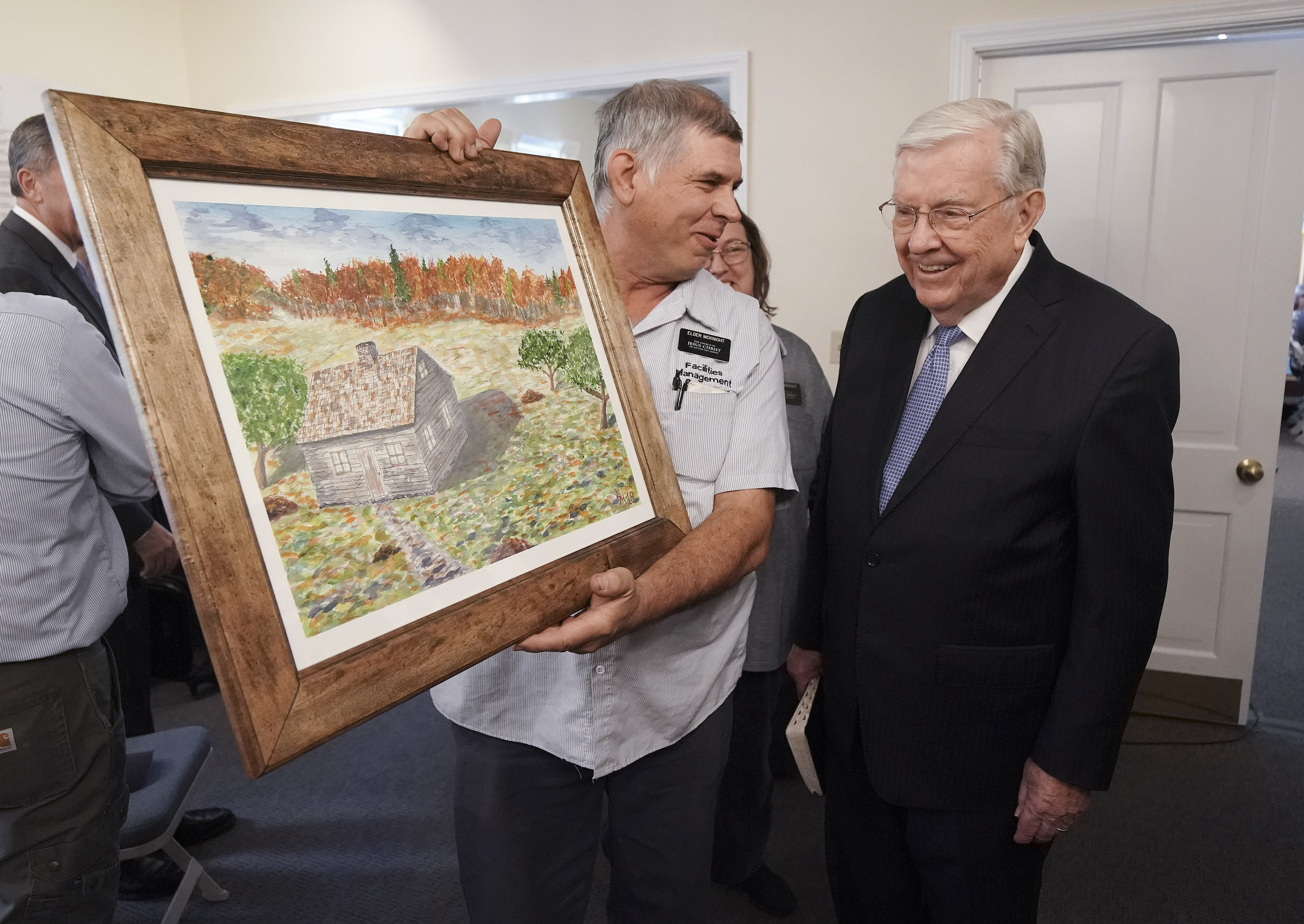 Elder Larry McKnight shows a painting he painted of the Joesph Smith Sr. cabin to President M. Russell Ballard, acting president of the Quorum of the Twelve Apostles of The Church of Jesus Christ of Latter-day Saints, prior to a missionary meeting at the Joseph Smith Birthplace Memorial in Sharon, Vt., on Saturday, Oct. 19, 2019.