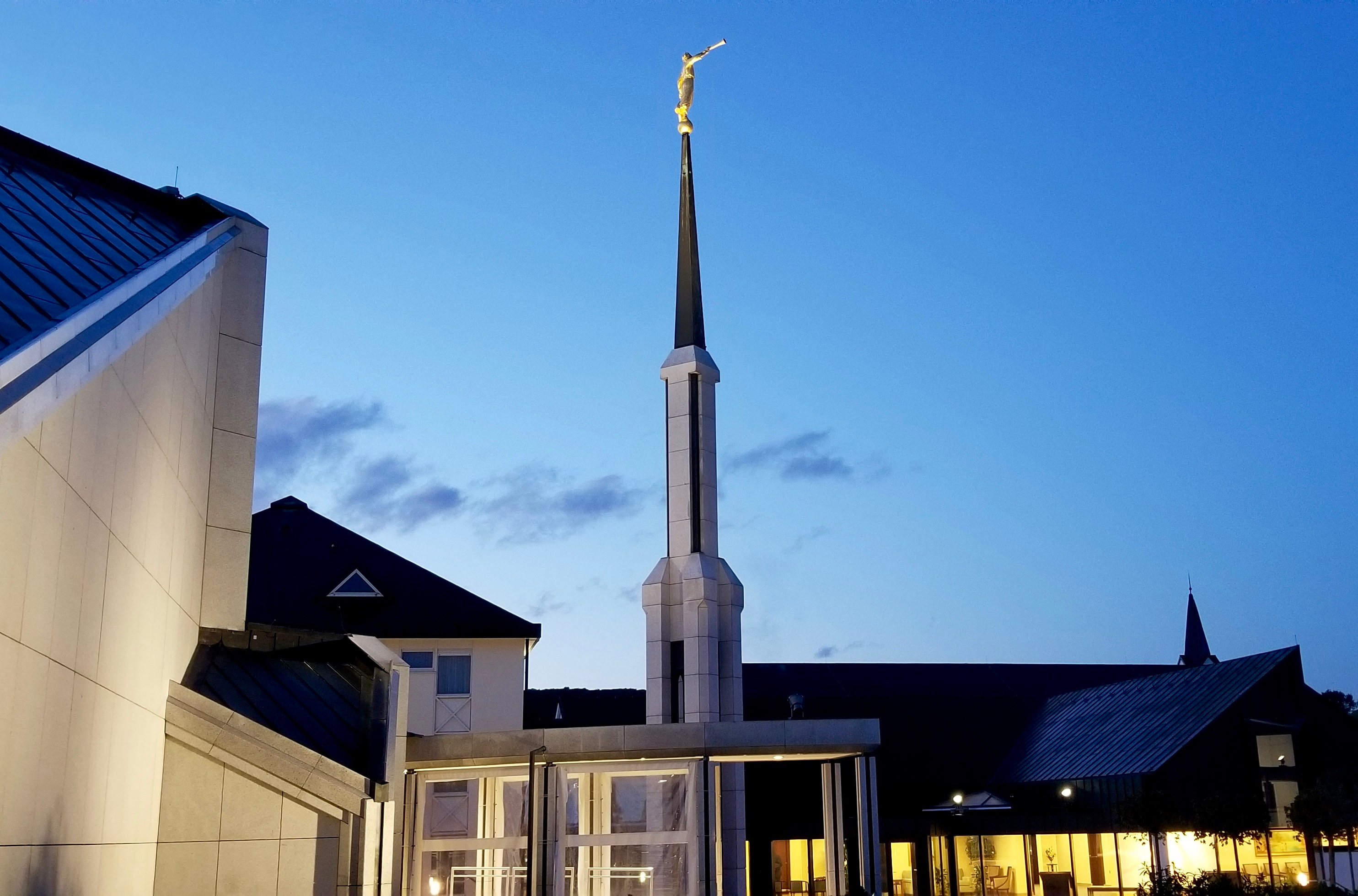 The Frankfurt Germany Temple at dusk on Oct. 18, 2019, with the temple annex and small visitors' area in the right background.