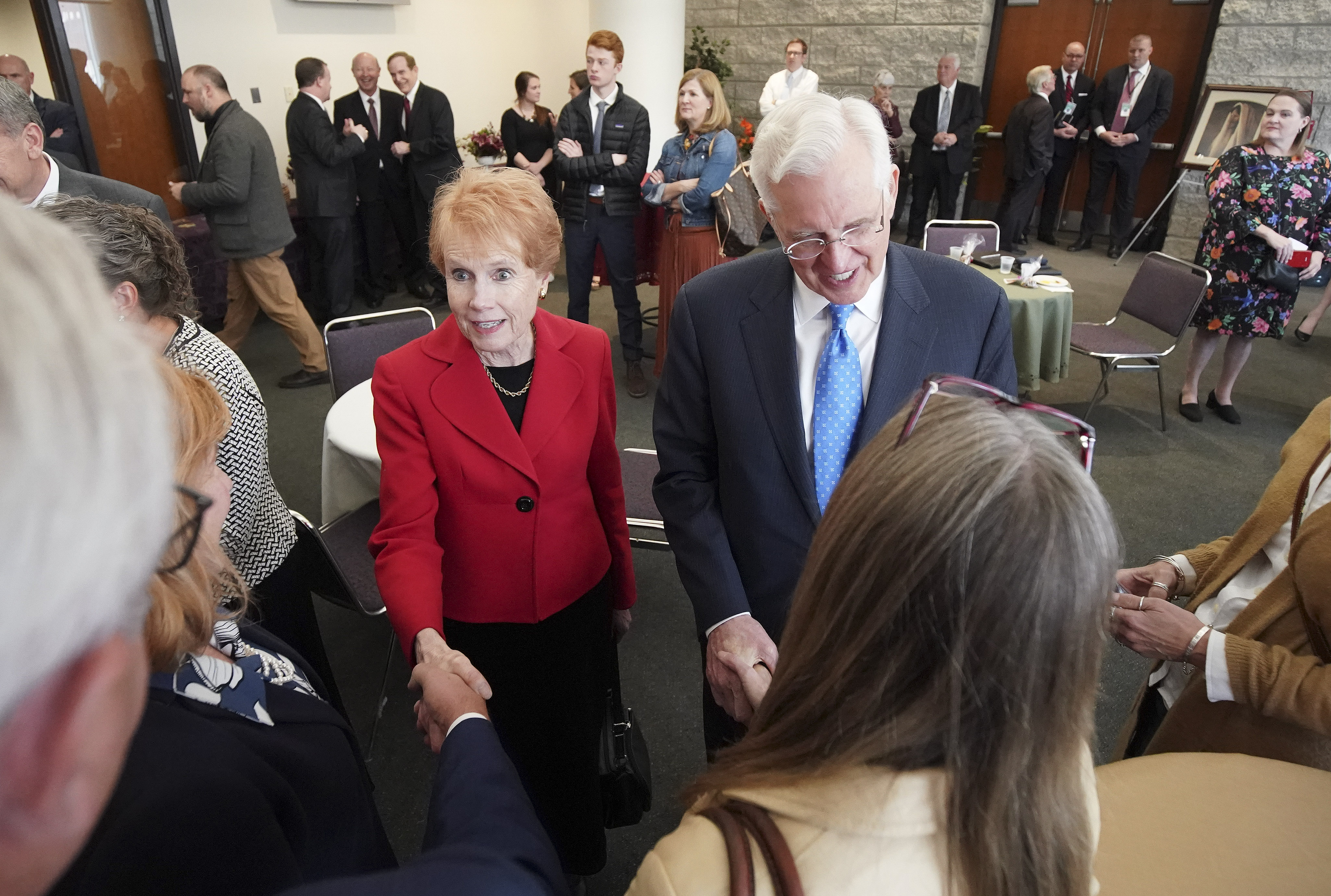 Elder D. Todd Christofferson, of The Church of Jesus Christ of Latter-day Saints' Quorum of the Twelve Apostles, holds hands with his wife, Sister Kathy Christofferson, as they meet with local dignitaries in Worcester, Massachusetts, on Sunday, Oct. 20, 2019.