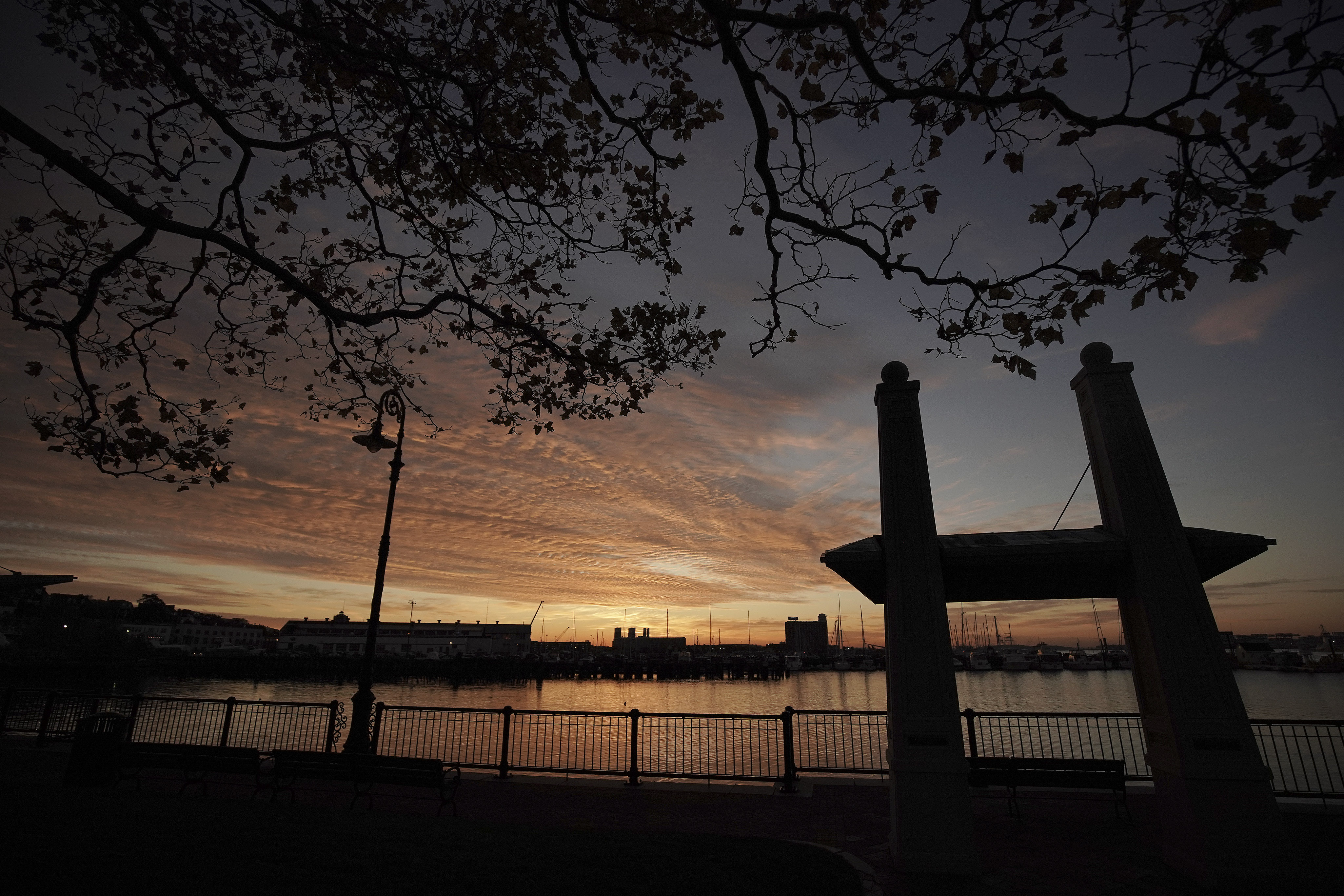 The sun rises on Jeffries Point in Boston on Sunday, Oct. 20, 2019.