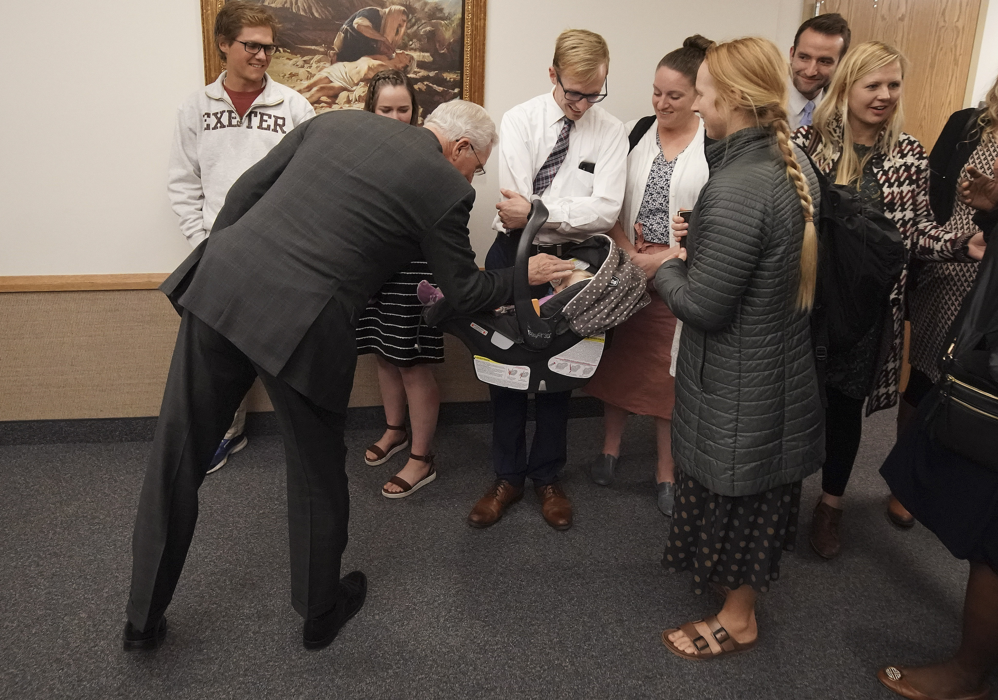 Elder D. Todd Christofferson, of The Church of Jesus Christ of Latter-day Saints' Quorum of the Twelve Apostles, visits 11-month-old Millie Morey and parents Zack and Hailey after a fireside in Boston on Saturday, Oct. 19, 2019.