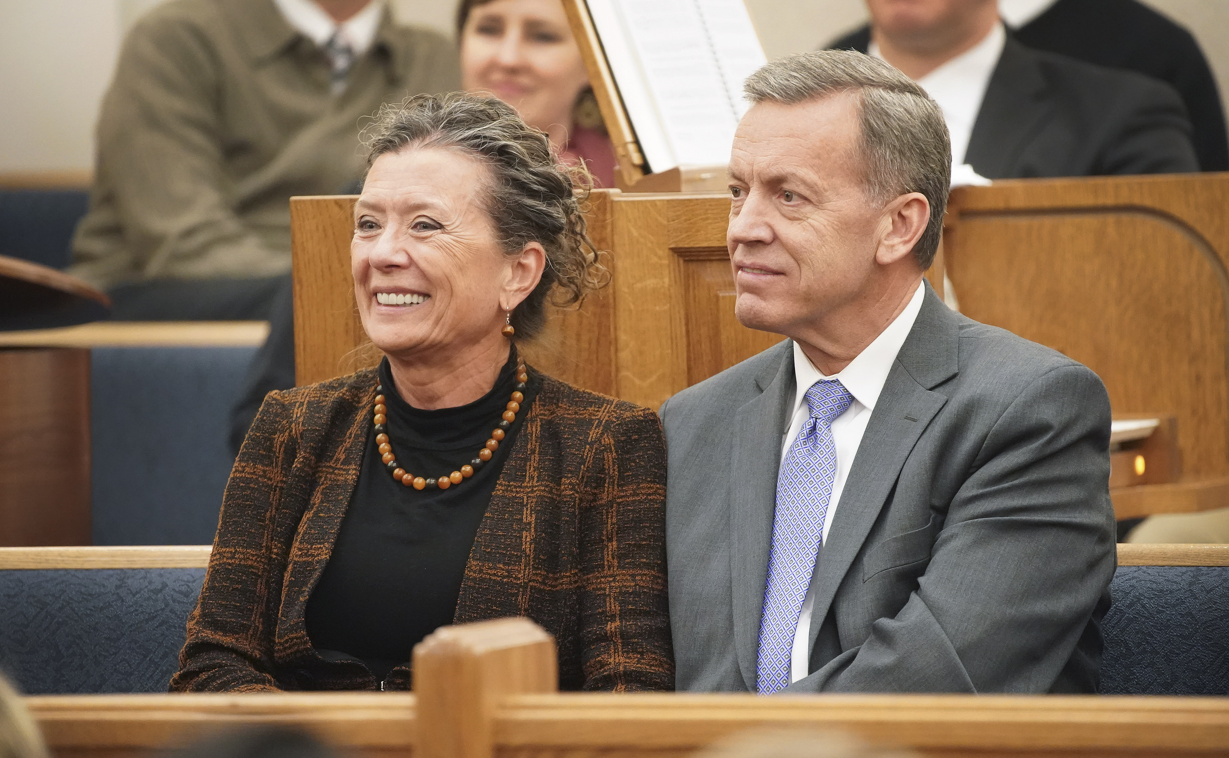 Elder Randall Bennett, General Authority Seventy of The Church of Jesus Christ of Latter-day Saints, sits with his wife, Sister Shelley Bennett, during a fireside in Boston on Saturday, Oct. 19, 2019.