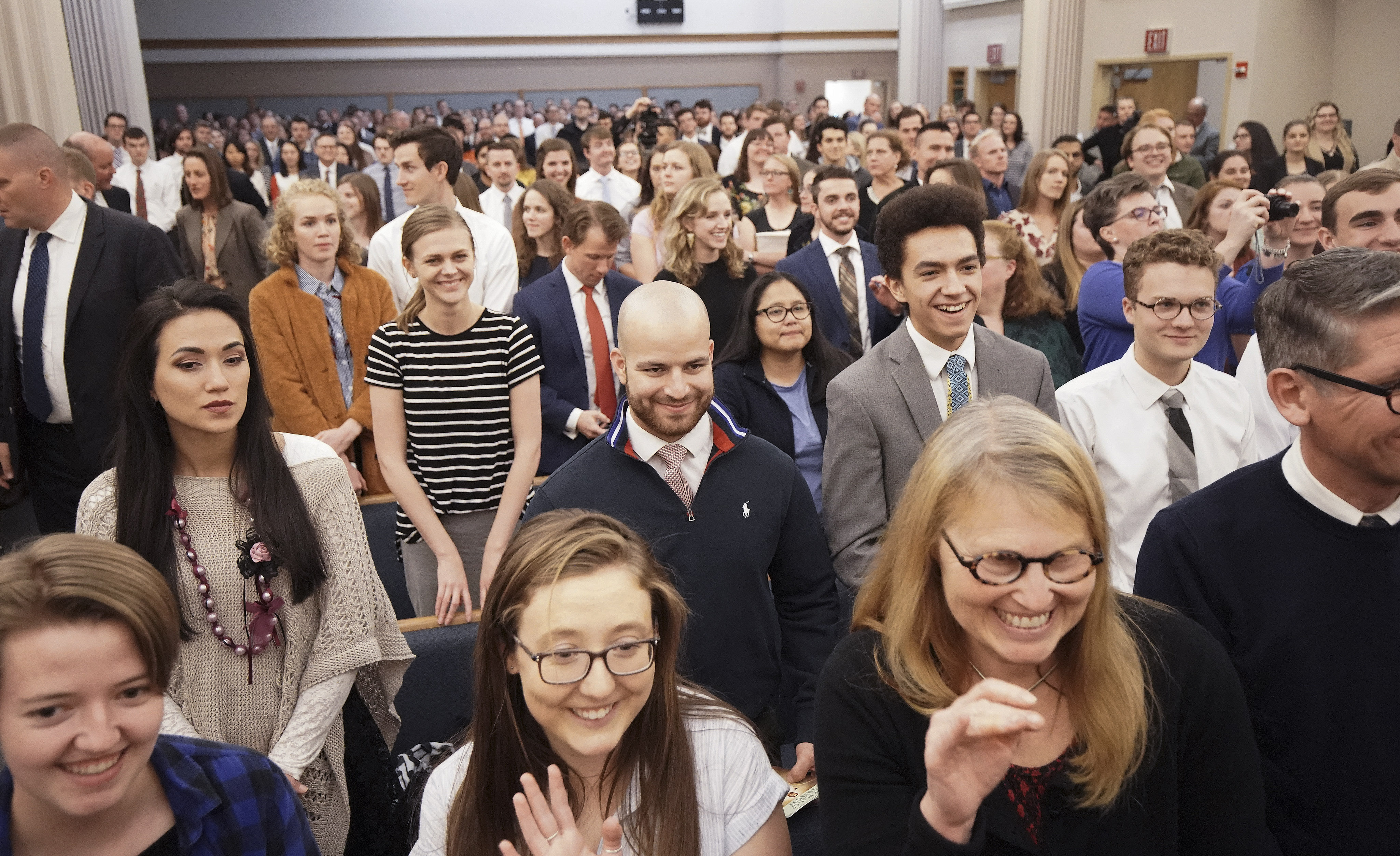 Attendees watch as President M. Russell Ballard, acting president of the Quorum of the Twelve Apostles of The Church of Jesus Christ of Latter-day Saints, enters the stake center in Boston on Saturday, Oct. 19, 2019.