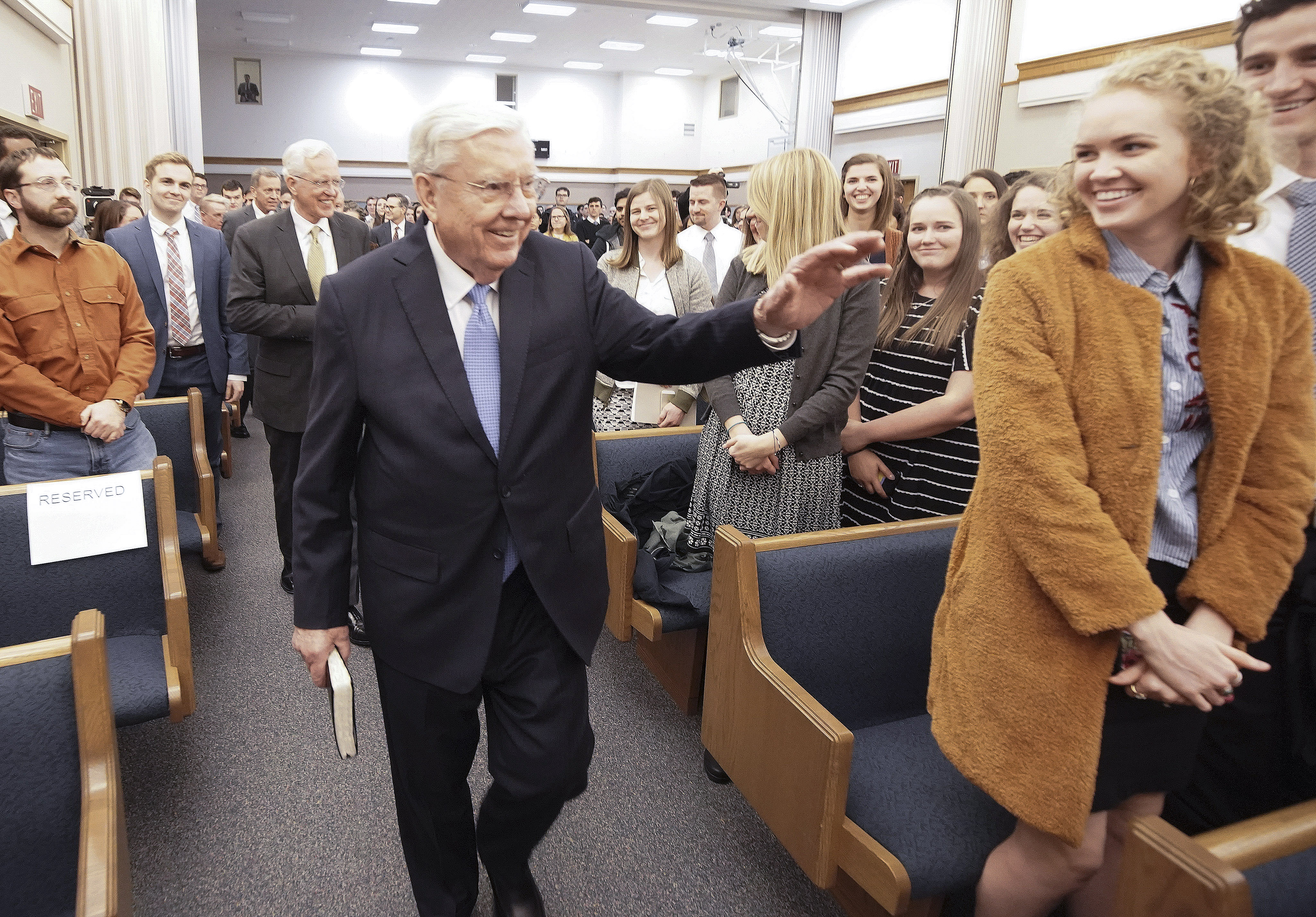 President M. Russell Ballard, acting president of the Quorum of the Twelve Apostles of The Church of Jesus Christ of Latter-day Saints, waves to attendees upon entering the stake center in Boston on Saturday, Oct. 19, 2019.