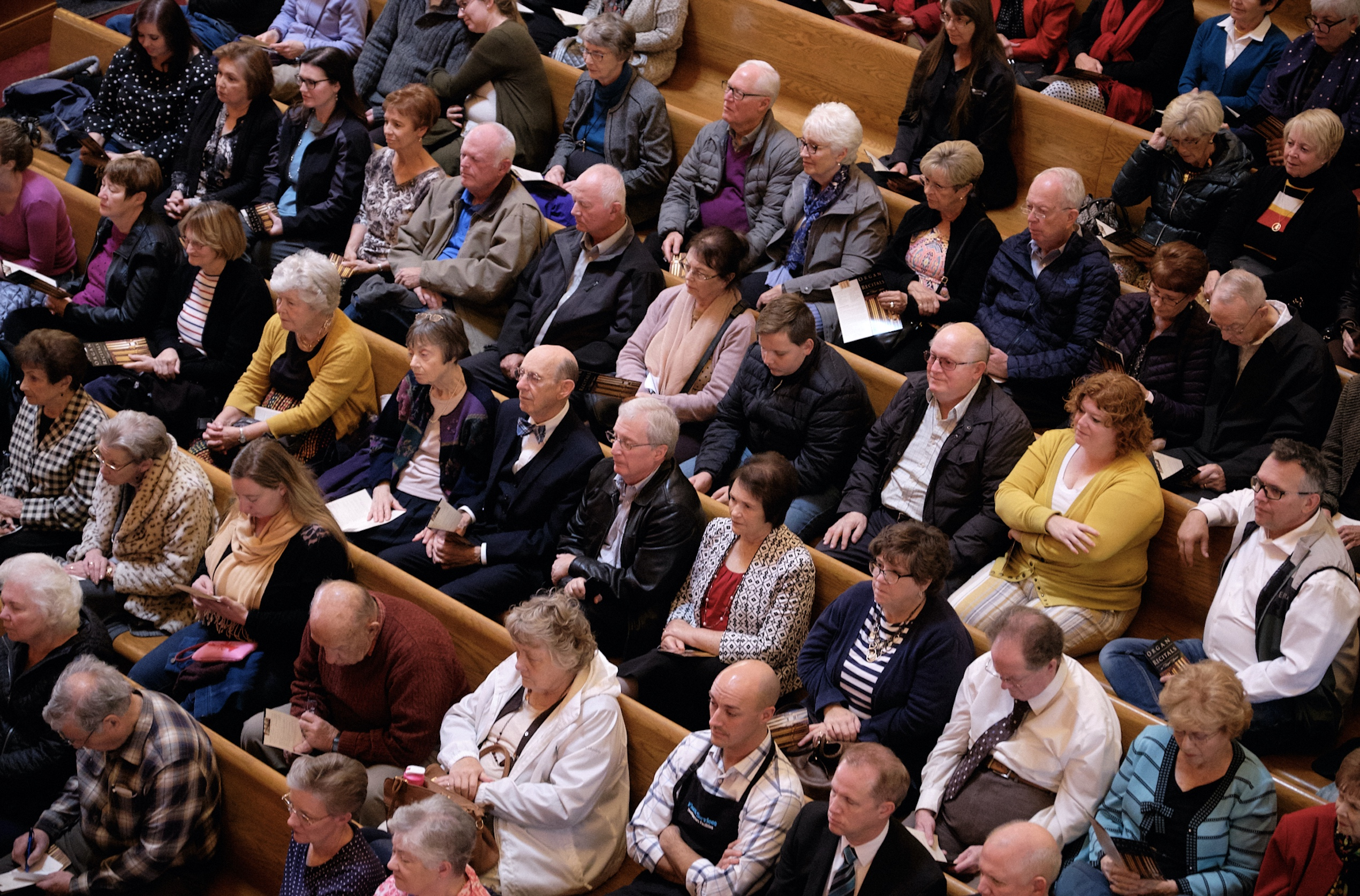 Family and friends listen during a recital performed by retiring Temple Square organist Bonnie Goodliffe at the Salt Lake Tabernacle on Monday, Oct. 21, 2019.