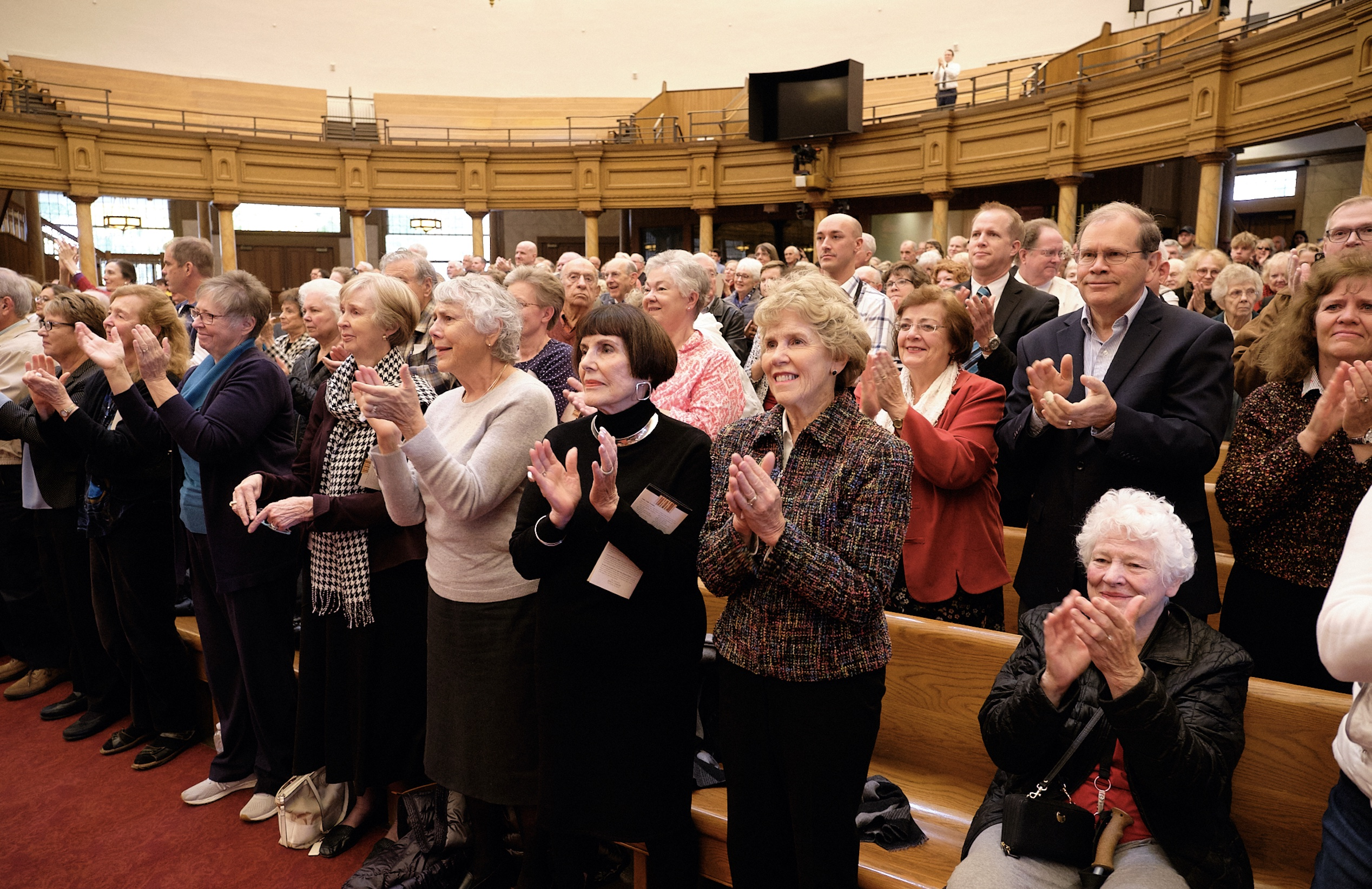 Family and friends give retiring Temple Square organist Bonnie Goodliffe a standing ovation after 40 years of service at the Salt Lake Tabernacle on Monday, Oct. 21, 2019.