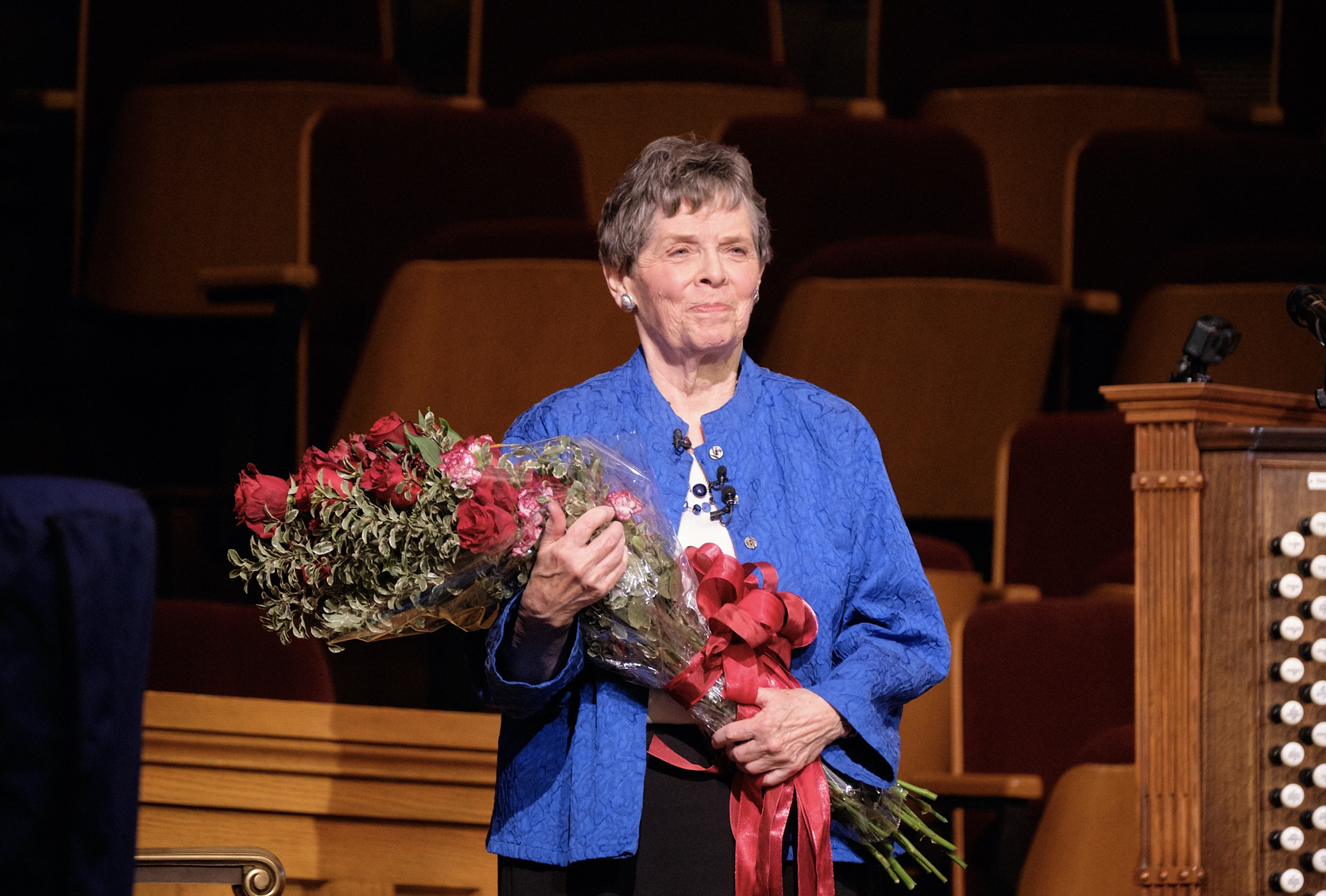 Retiring Temple Square organist Bonnie Goodliffe, accepts a bouquet of red roses at the Salt Lake Tabernacle after 40 years of service on Monday, Oct. 21, 2019.