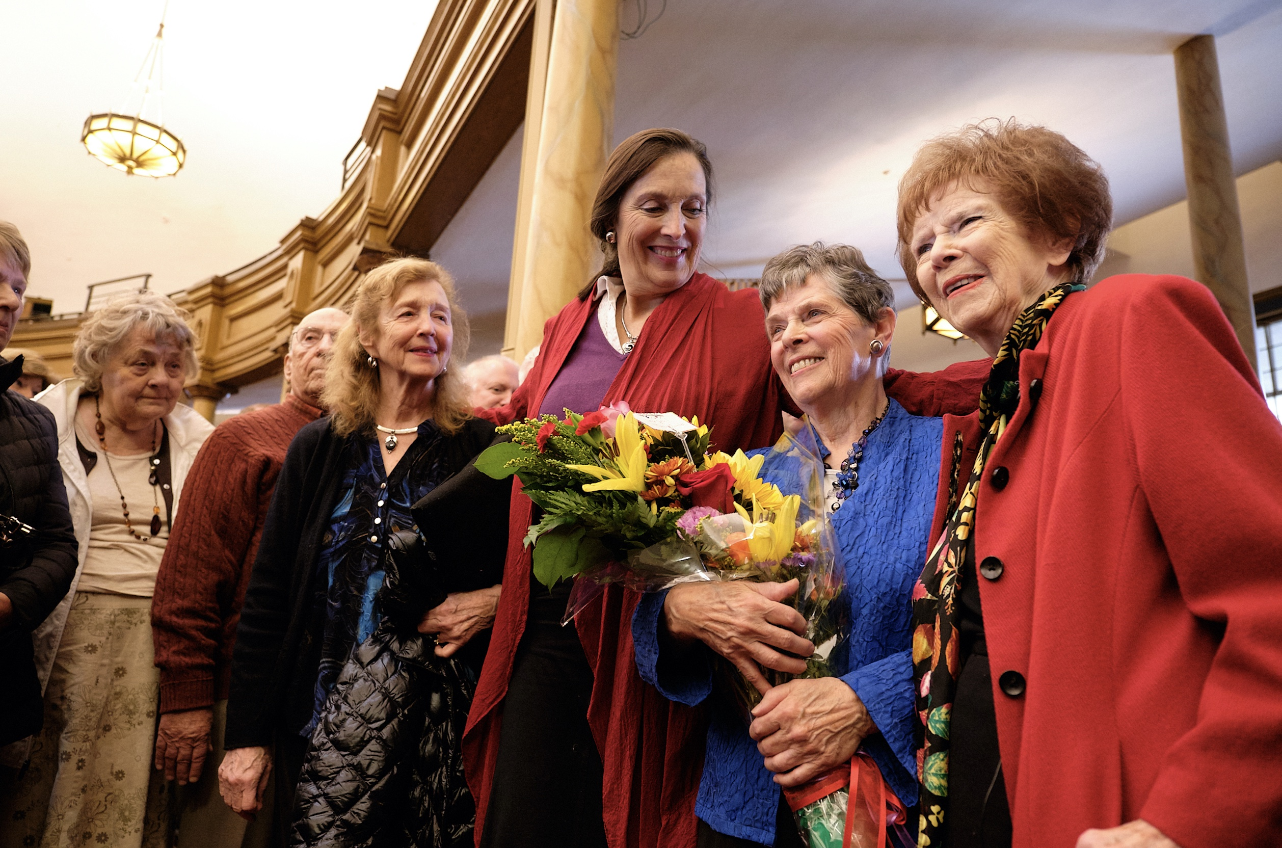 Retiring Temple Square organist Bonnie Goodliffe, holding flowers, stands for a photo among family and friends at the Salt Lake Tabernacle on Monday, Oct. 21, 2019.
