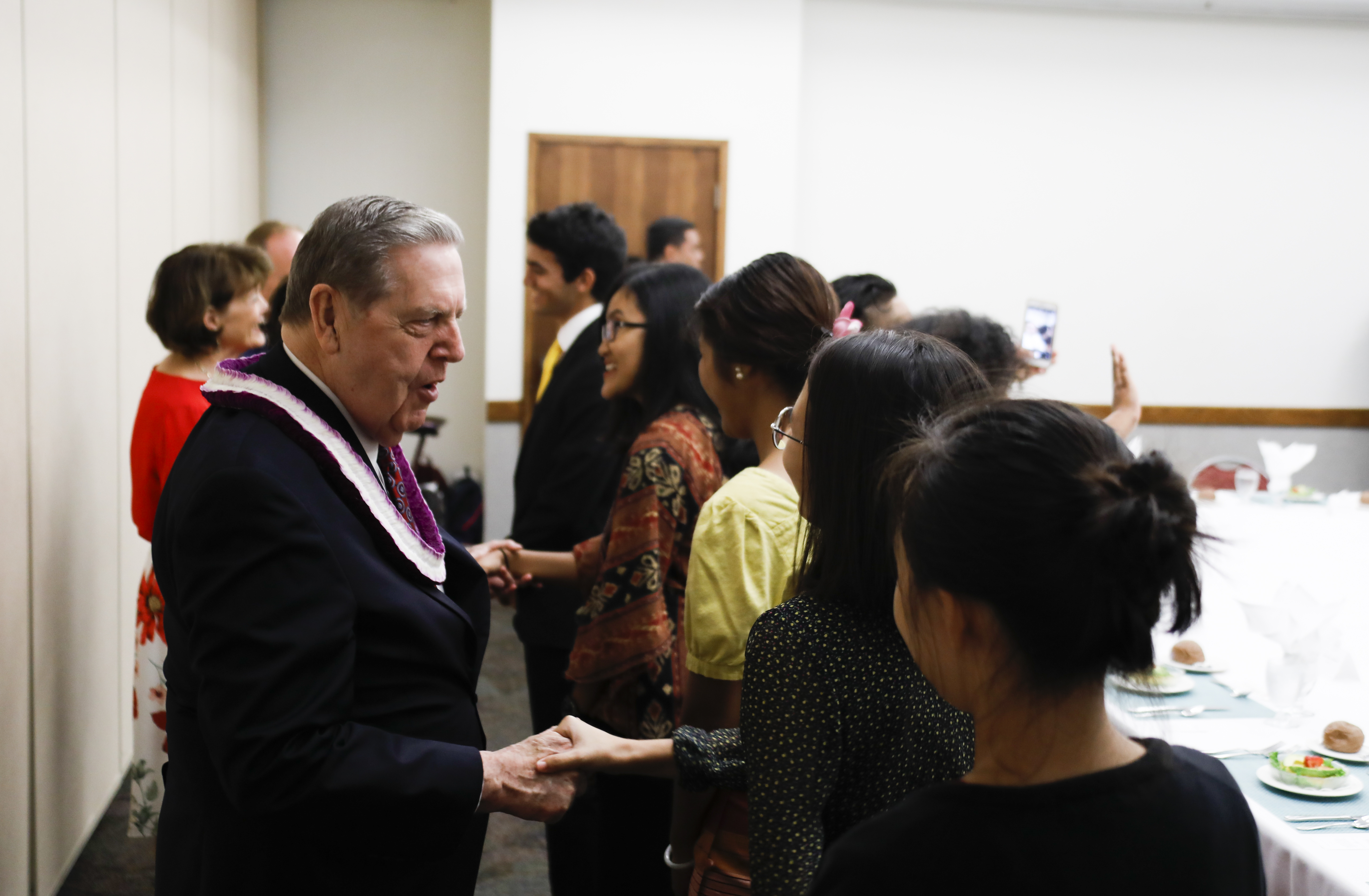 Elder Jeffrey R. Holland greets students following his devotional address at BYU-Hawaii on Oct. 22.