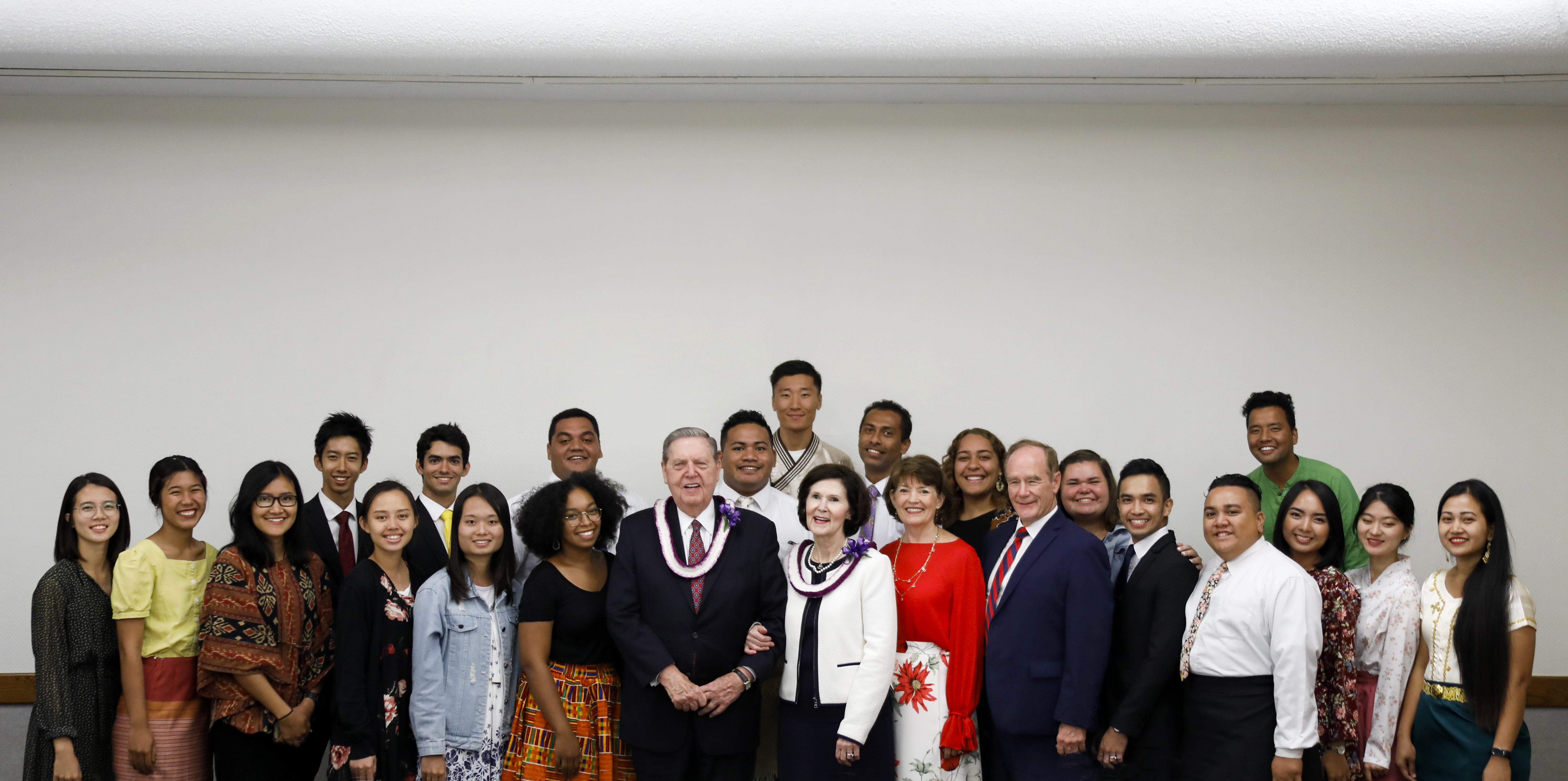 Elder Jeffrey R. Holland and his wife, Sister Patricia Holland, are pictured with BYU-Hawaii President John S. Tanner and his wife, Sister Susan W. Tanner, along with a group of students.