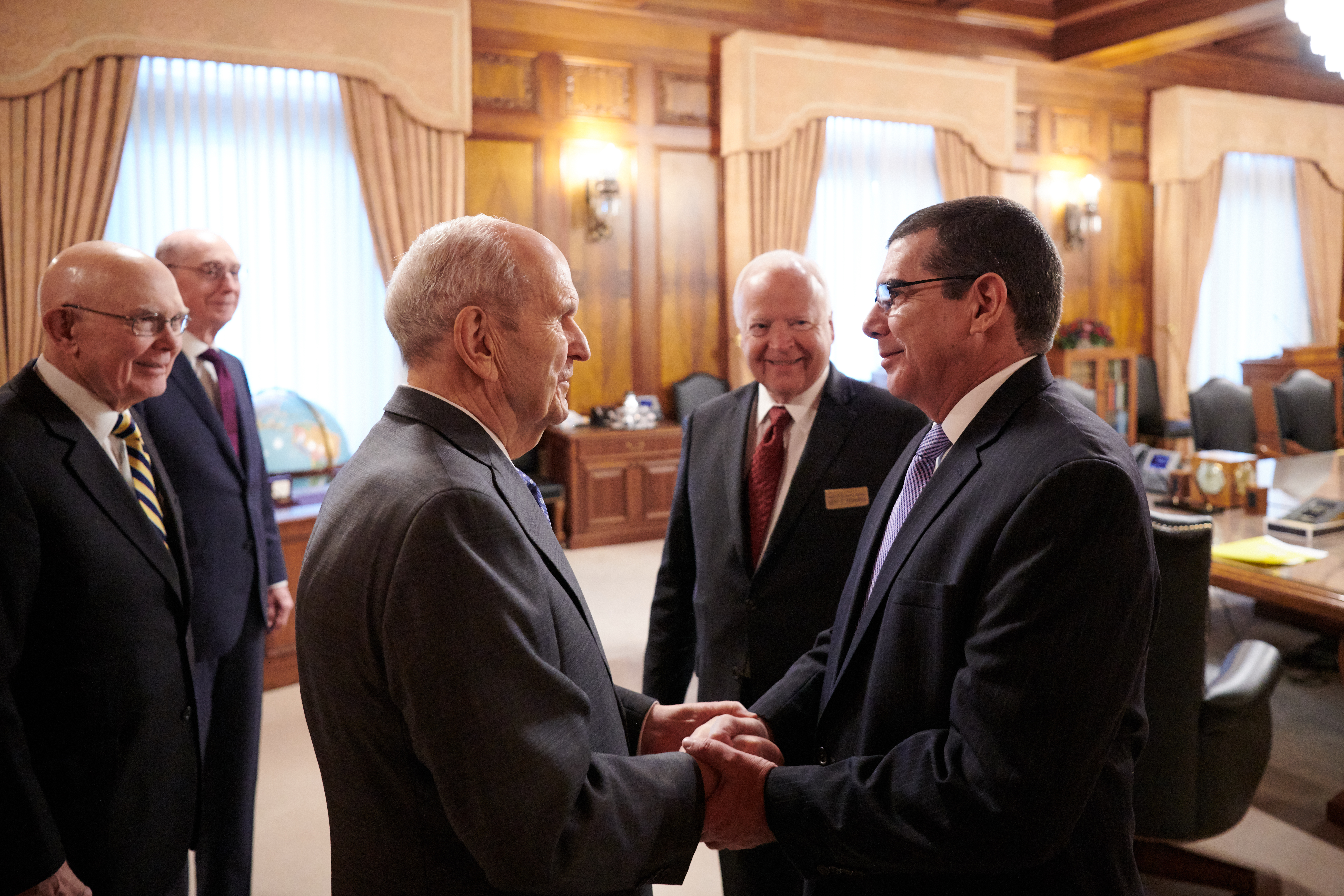 President Russell M. Nelson of The Church of Jesus Christ of Latter-day Saints greets Cuba's Ambassador to the United States, José R. Cabañas, on Oct. 23, 2019.