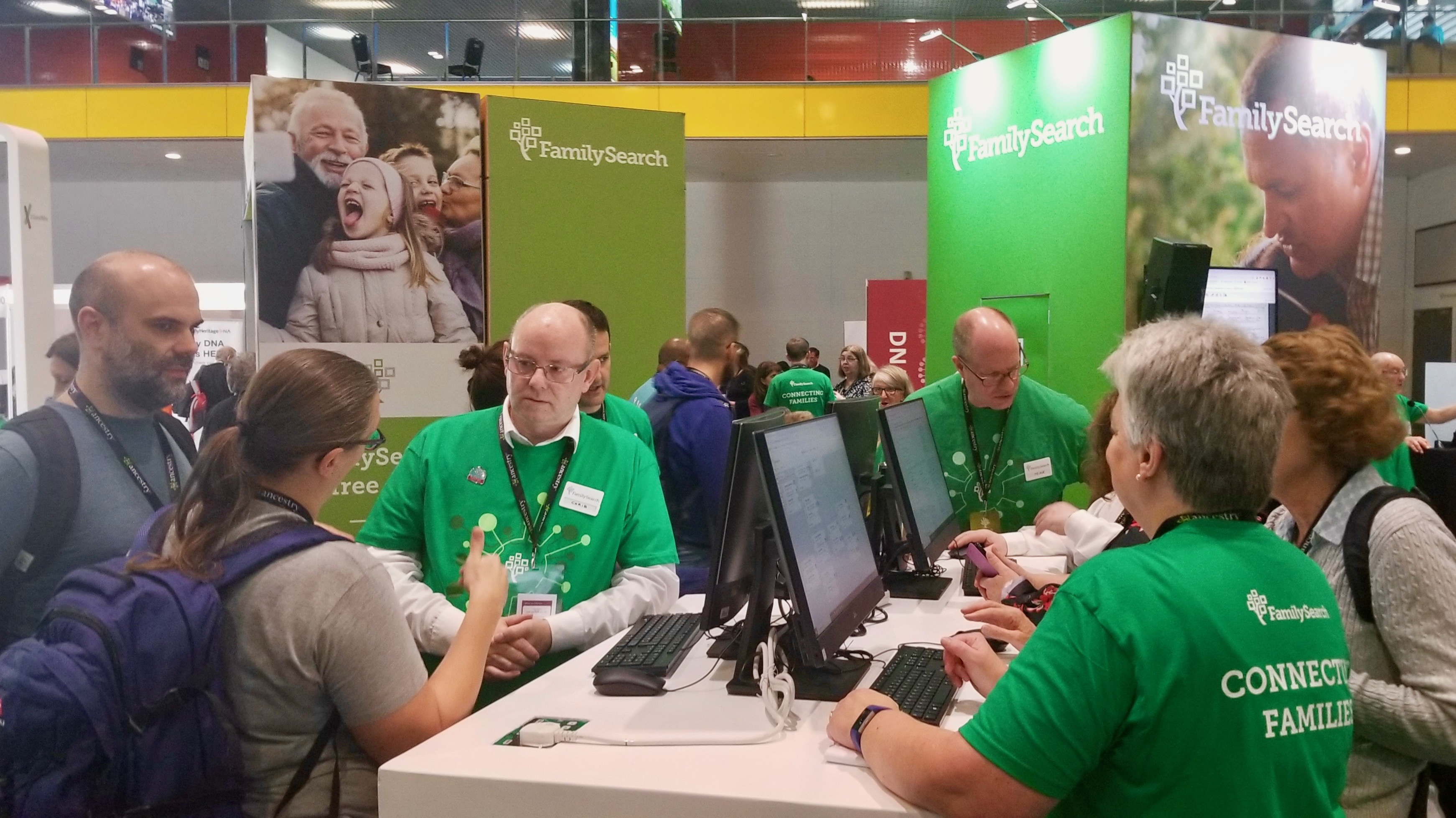 RootsTech London attendees and FamilySearch assistants gather at the FamilySearch booth in the London ExCel exhibition hall on Thursday, Oct. 24. 2019.