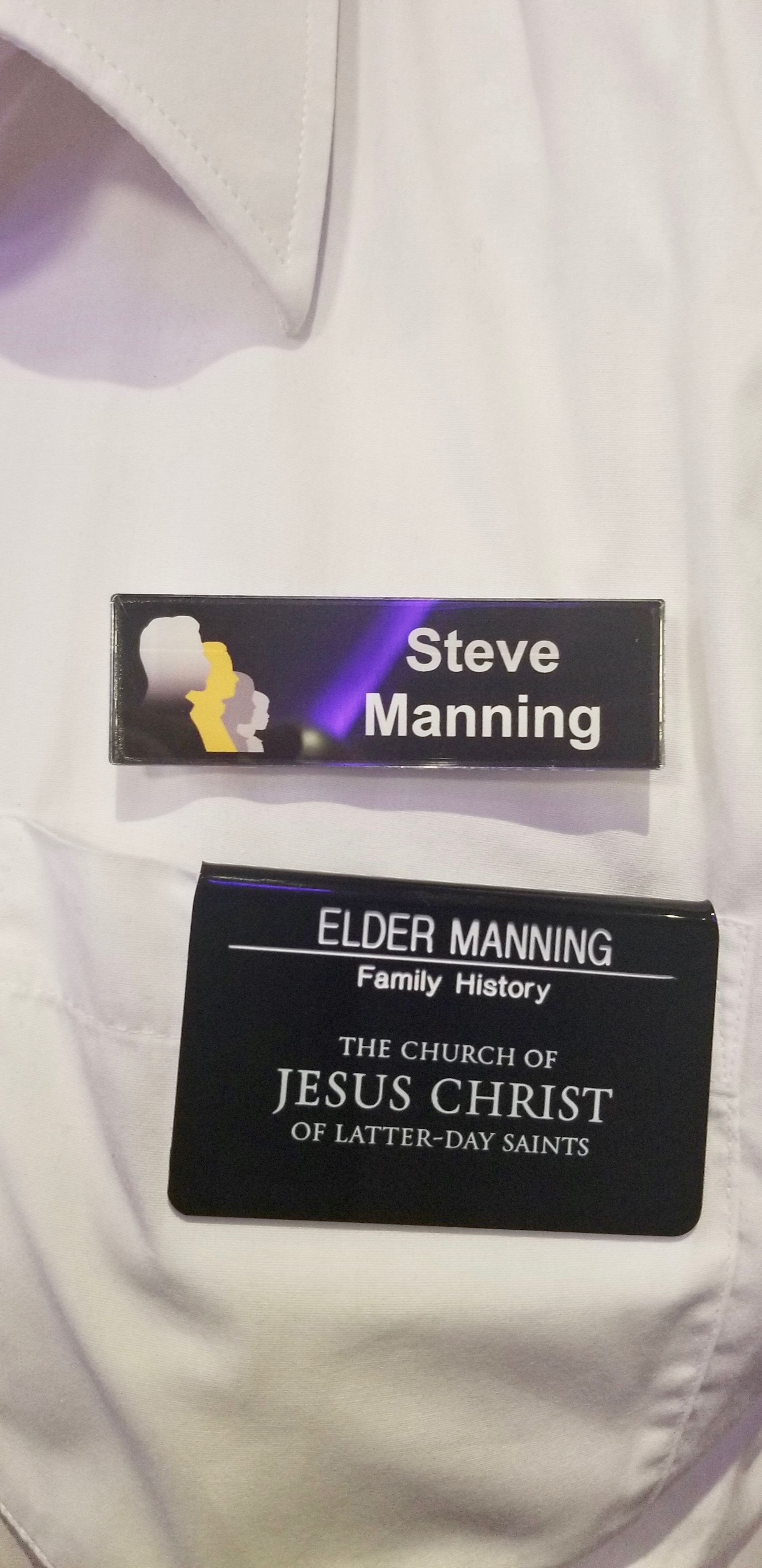 Steve Manning's two name badges — one as chairman of the Family History Federation and the other as a Church-service family history missionary for The Church of Jesus Christ of Latter-day Saints. Photo taken during RootsTech London on Oct. 24, 2019.