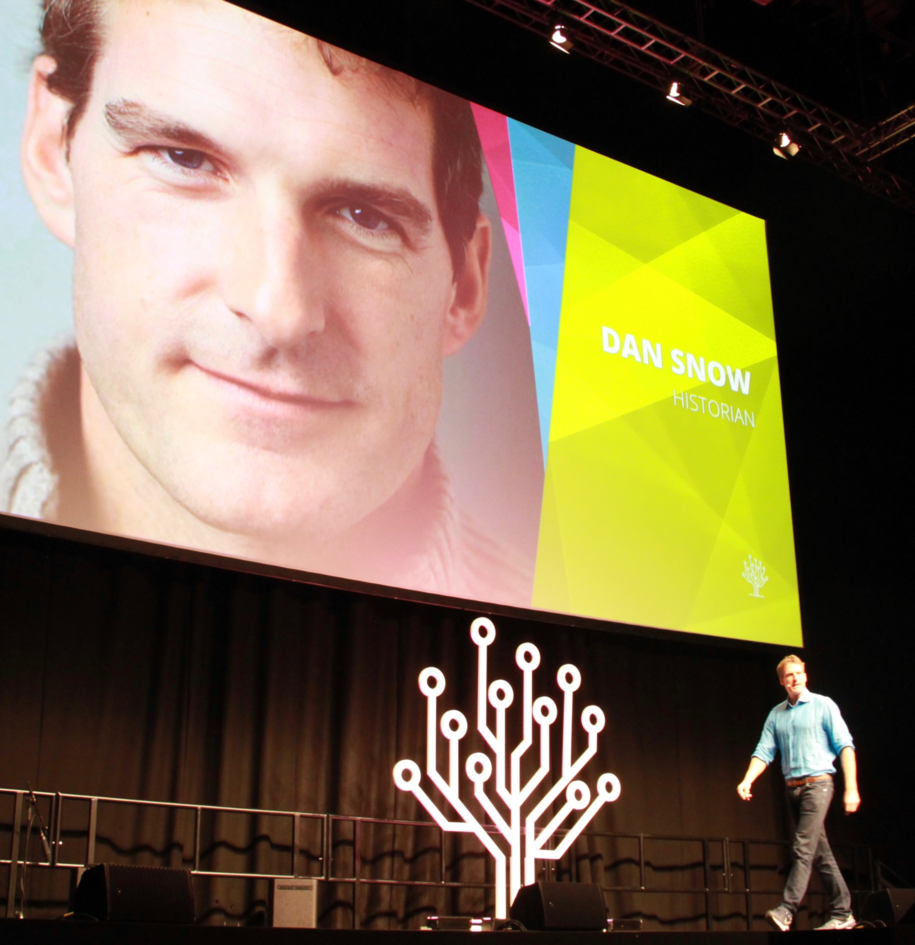 British historian and TV personality Dan Snow speaks during RootsTech London's General Keynote event Thursday, Oct. 24, 2019, in the London ExCel auditorium.