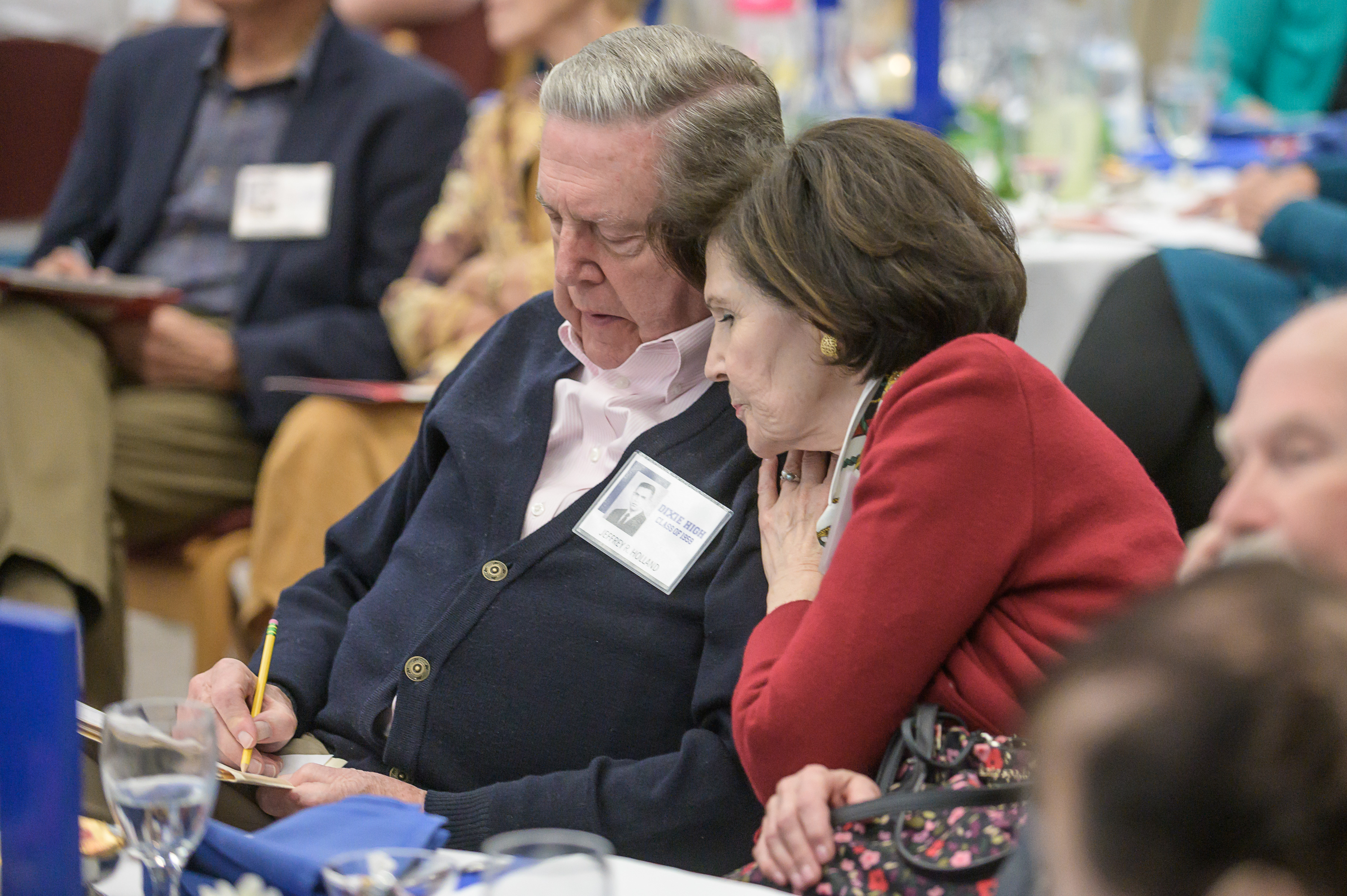 Patricia Holland, right, wife of Elder Jeffrey R. Holland, a member of the Quorum of the Twelve Apostles of The Church of Jesus Christ of Latter-day Saints, leans in to help with a musical quiz at the 60th reunion for the Dixie High School class of 1959 on Thursday, Oct. 24, 2019, in St. George.