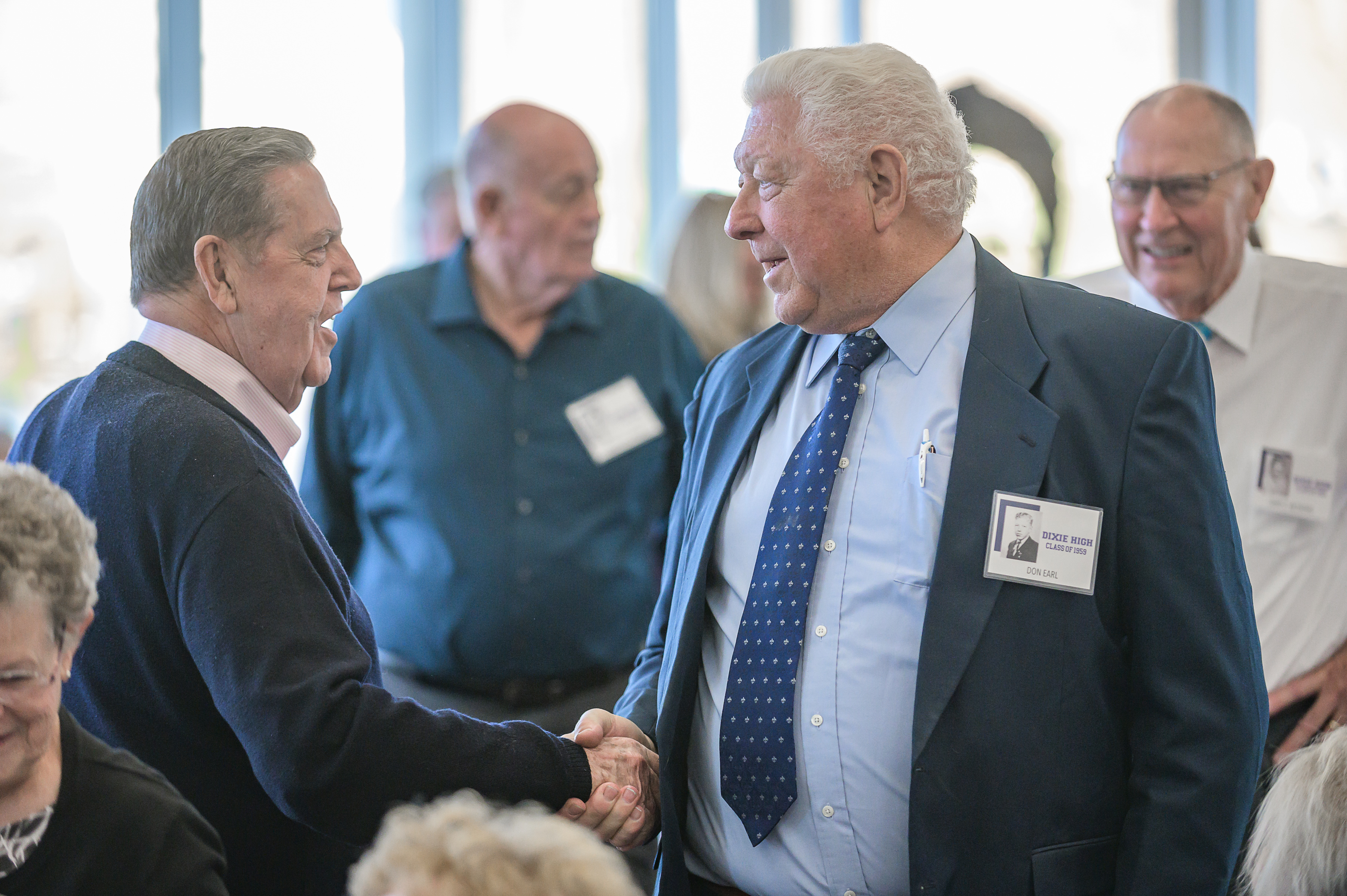 Elder Jeffrey R. Holland, left, a member of the Quorum of the Twelve Apostles of The Church of Jesus Christ of Latter-day Saints, shakes hands with classmate Don Earl at the 60th reunion for the Dixie High School class of 1959 on Thursday, Oct. 24, 2019, in St. George.