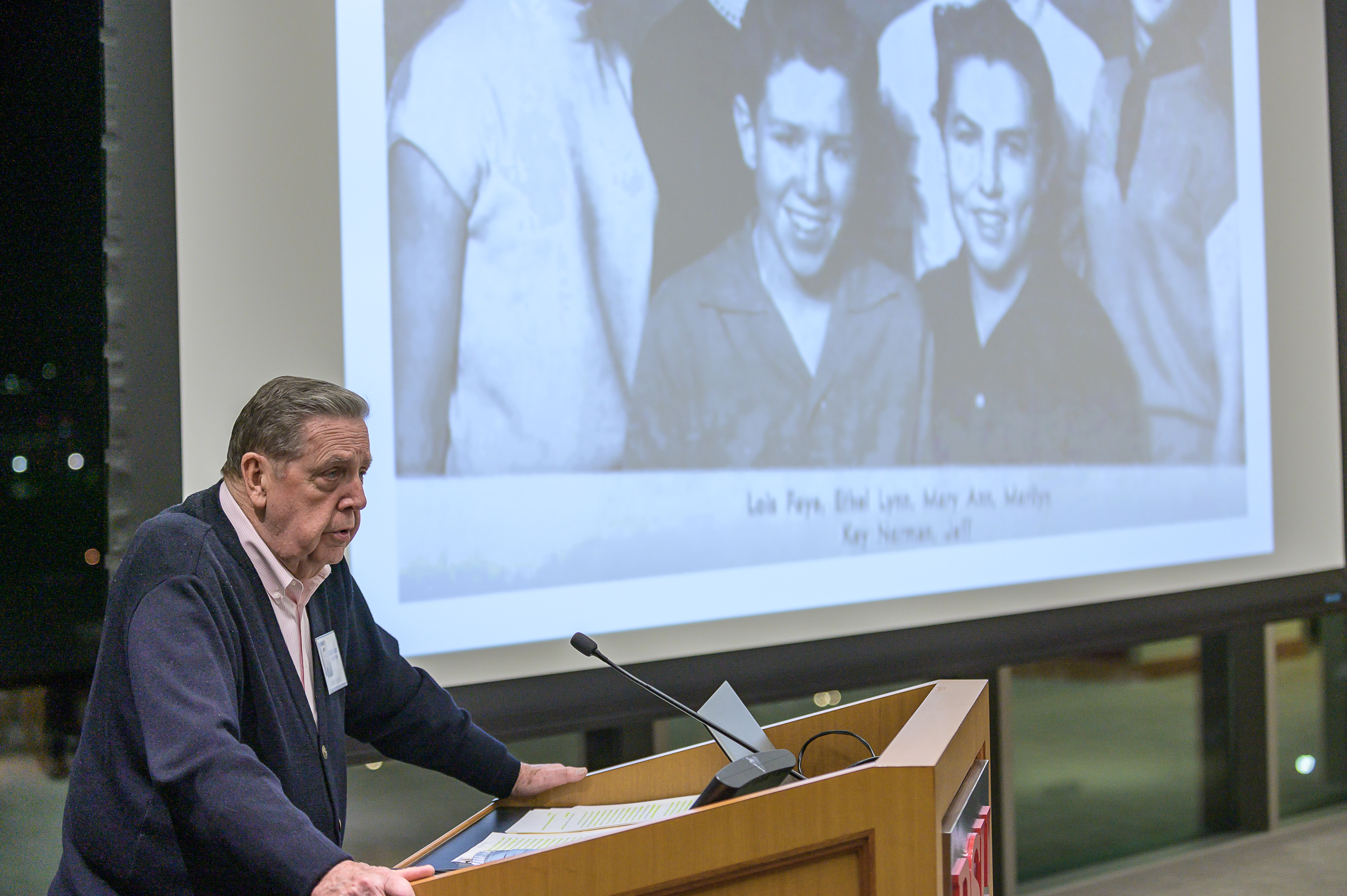 Elder Jeffrey R. Holland, a member of the Quorum of the Twelve Apostles of The Church of Jesus Christ of Latter-day Saints, is flanked by a photograph of himself as a young man, on right in photo, while speaking to his high school classmates and other guests at the 60-year reunion for the Dixie High School class of 1959 on Thursday, Oct. 24, 2019, in St. George.
