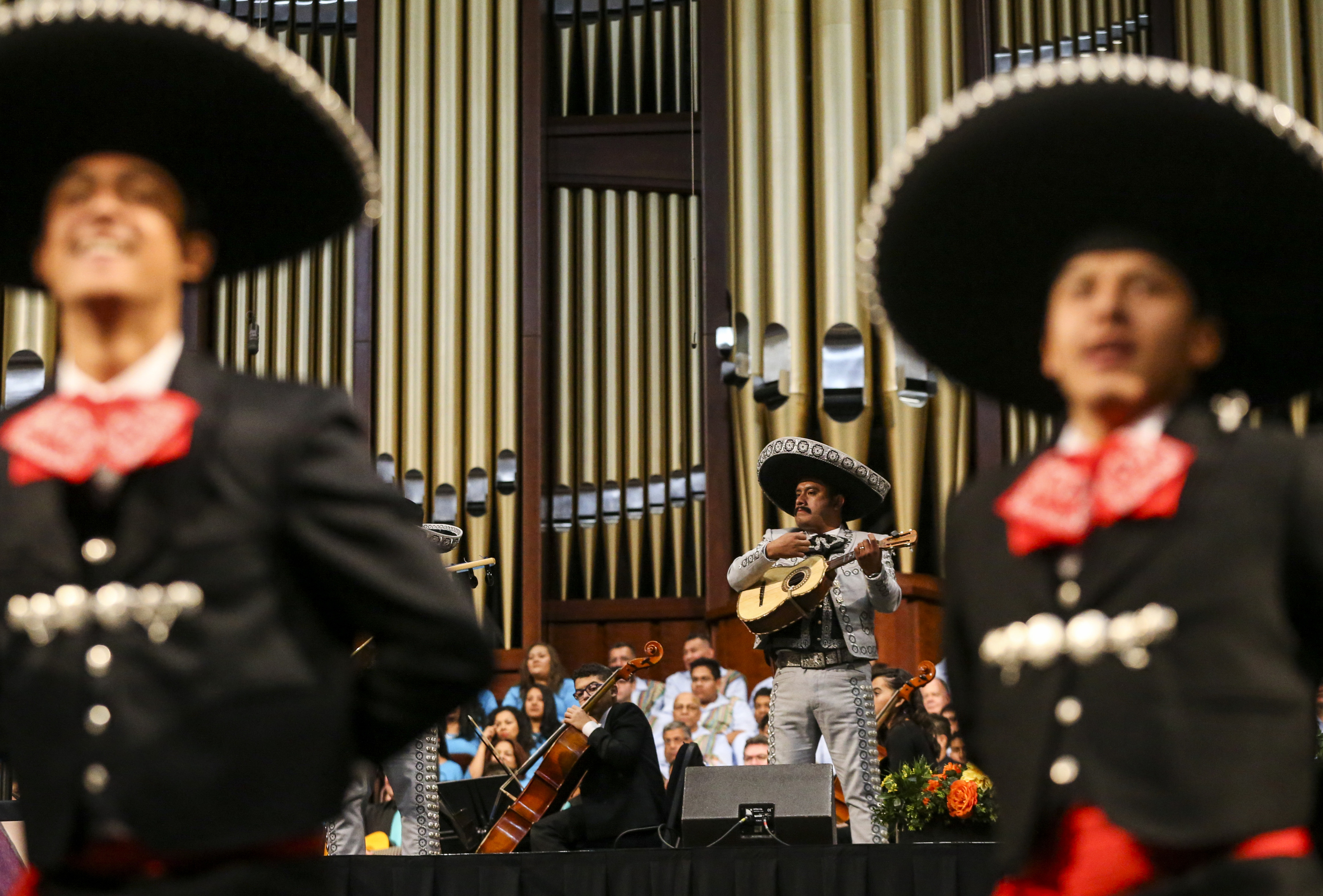 A member of the mariachi band performs with the dancers during the dress rehearsal of the Mexican dance Guadalajara LaNegra for the Luz de las Naciones performance at the Conference Center in Salt Lake City on Saturday, Oct. 26, 2019.
