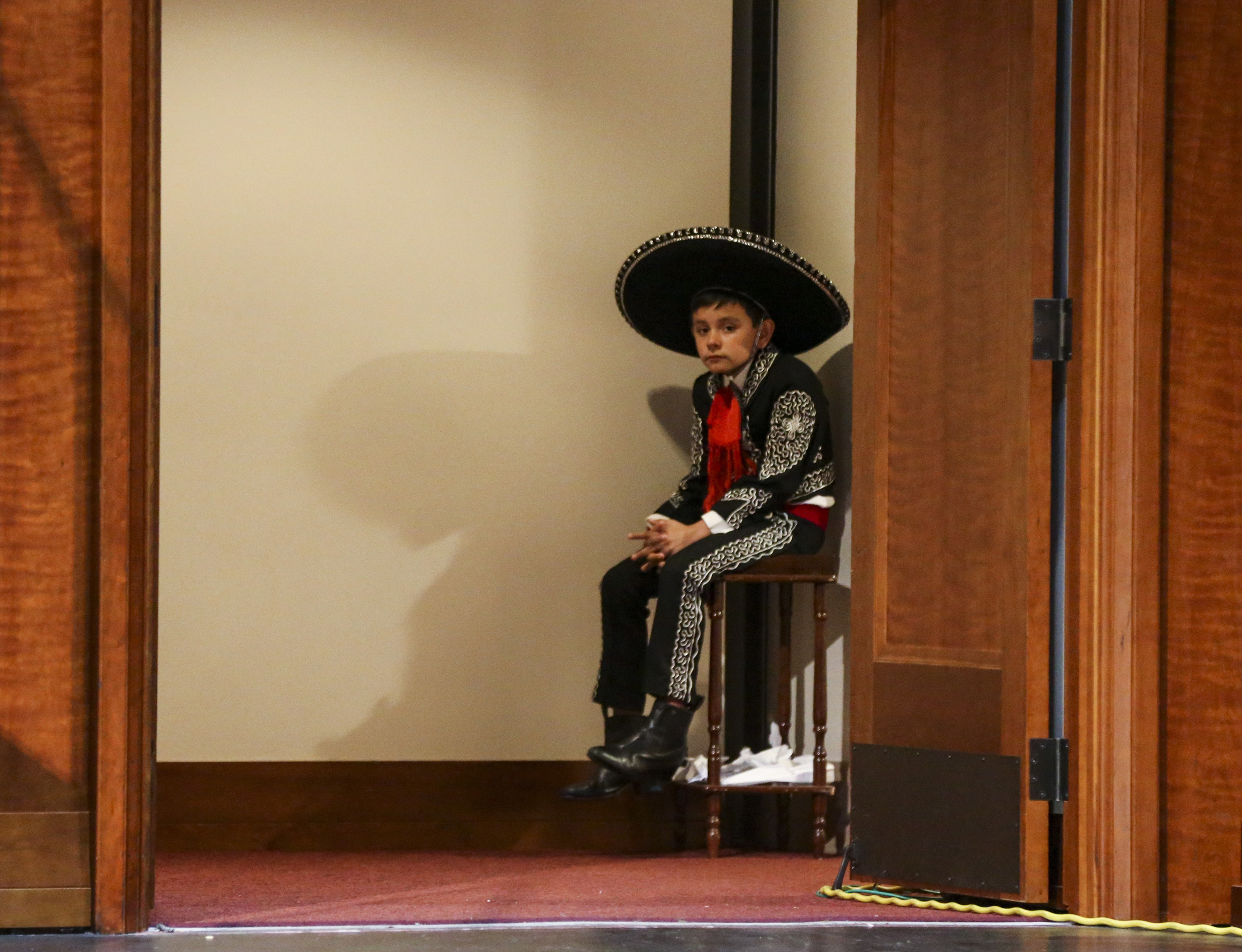 A young dancer waits to take the stage for the dress rehearsal of the Mexican dance Guadalajara LaNegra for the Luz de las Naciones performance at the Conference Center in Salt Lake City on Saturday, Oct. 26, 2019.