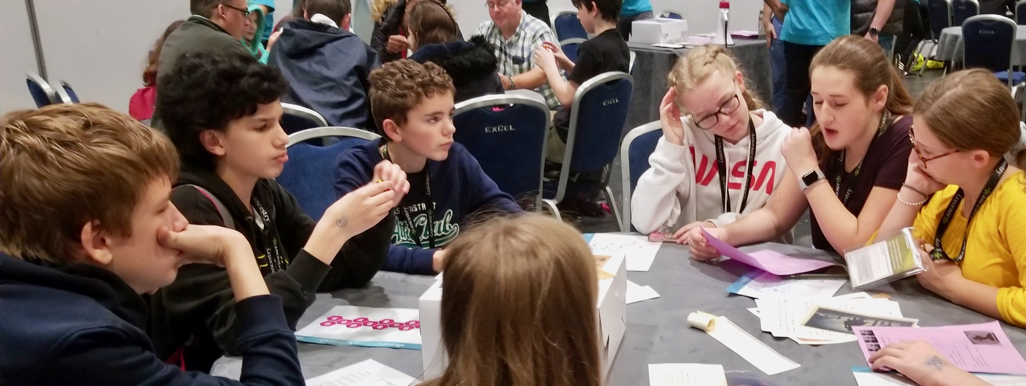 Youth participate in a family history-themed escape-room game as a RootsTech London discovery activity on Oct. 26, 2019.