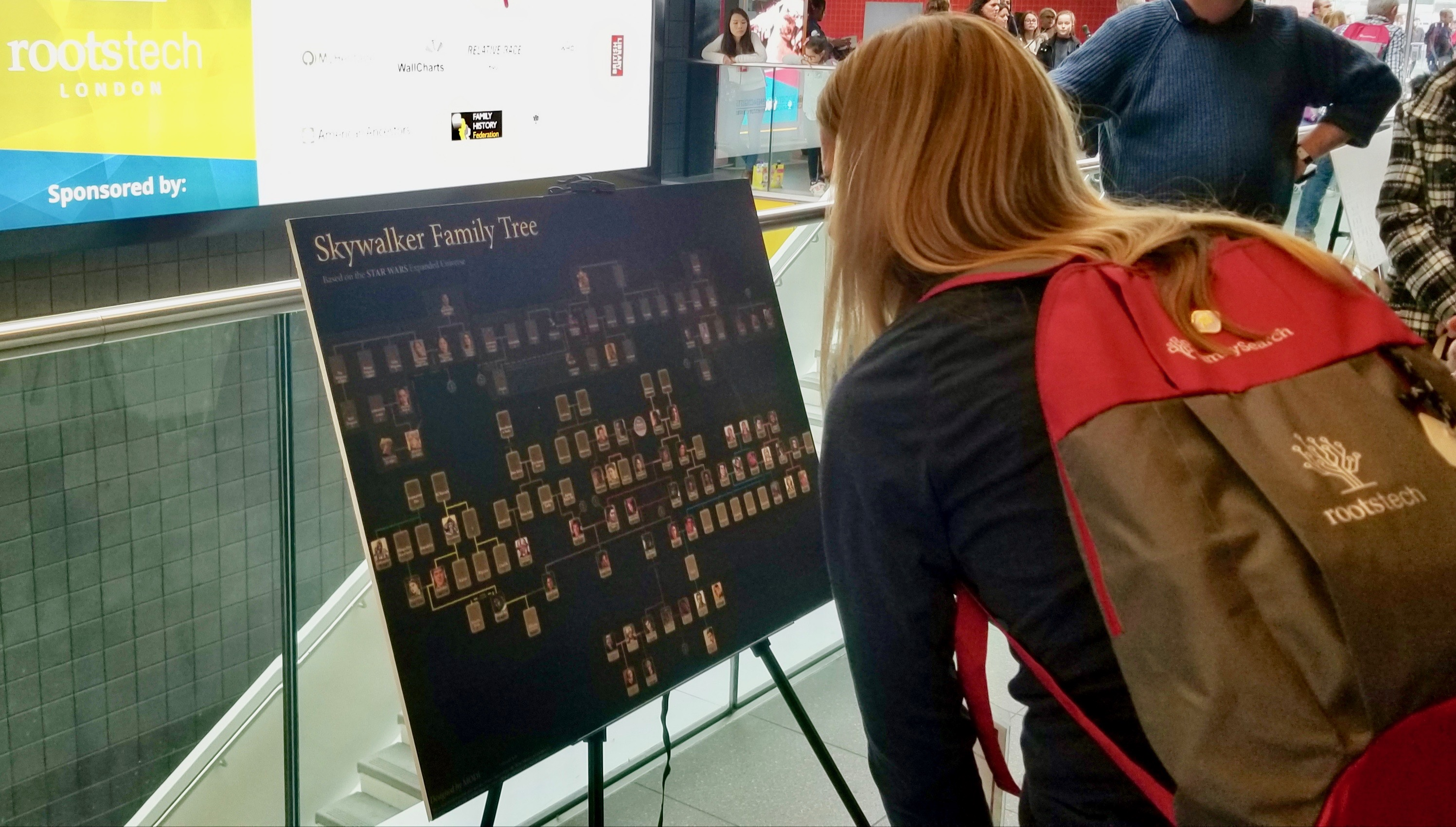 A RootsTech London attendee looks at a Luke Skywalker family pedigree chart — an effort to draw some attention and smiles from those participating in the neighboring Comic Con at the London ExCel on Oct. 26, 2019.