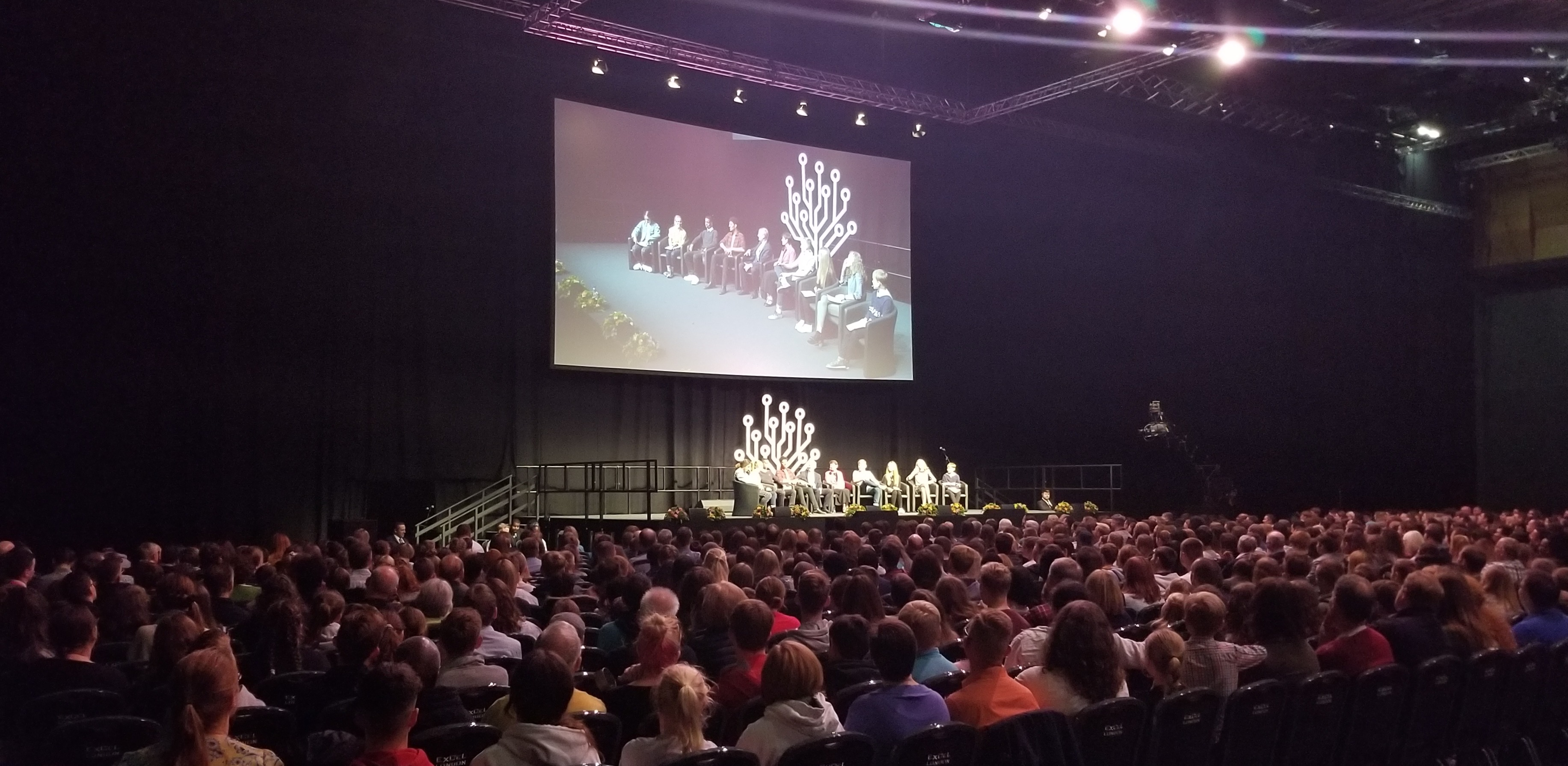 "Eight youth participate in the ""Youth Experience"" panel discussion with Elder and Sister Bednar during RootsTech London on Saturday, Oct. 26, 2019."
