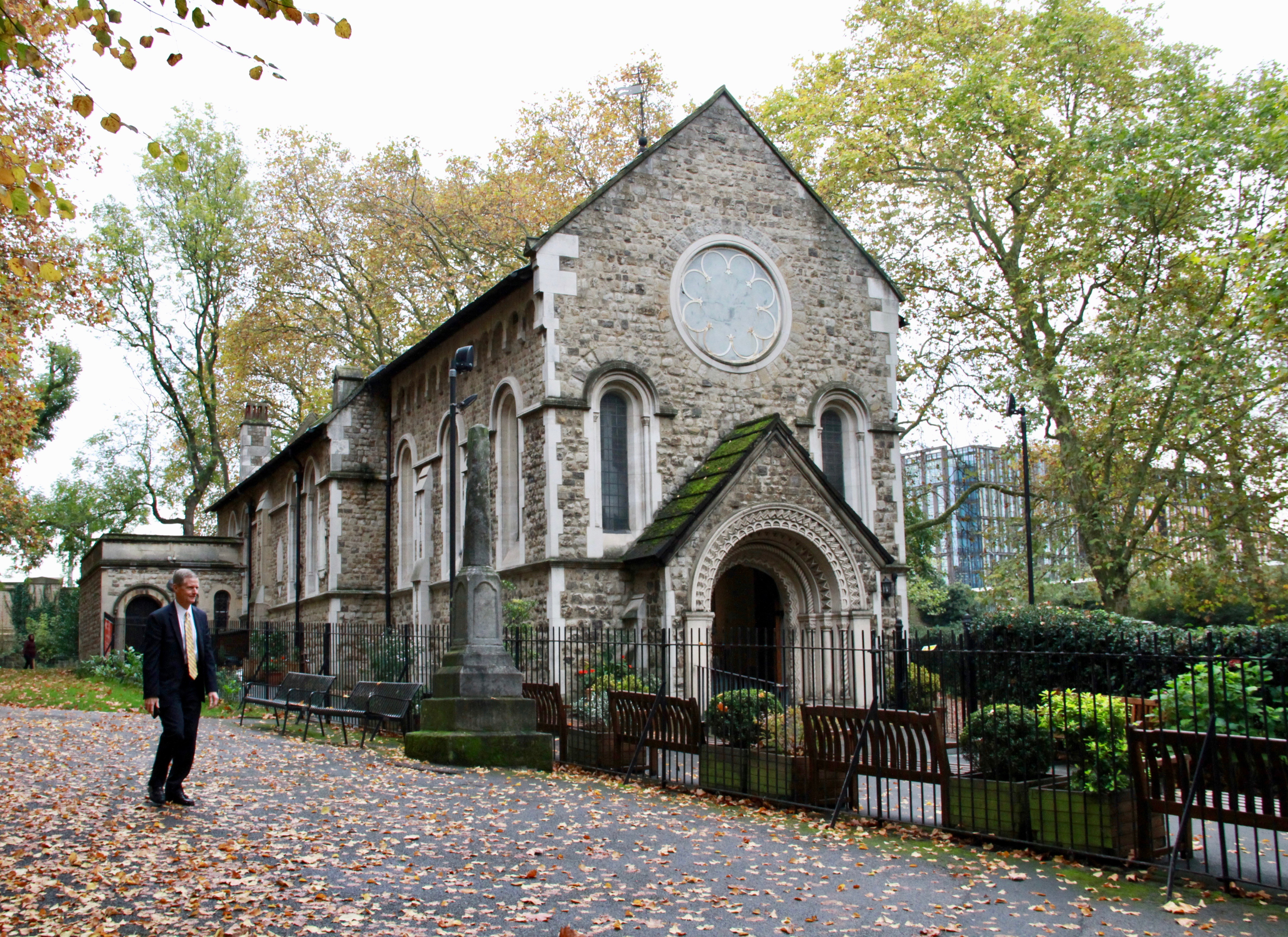 Elder David A. Bednar walks outside the St. Pancras Old Church in London on Oct. 25, 2019.