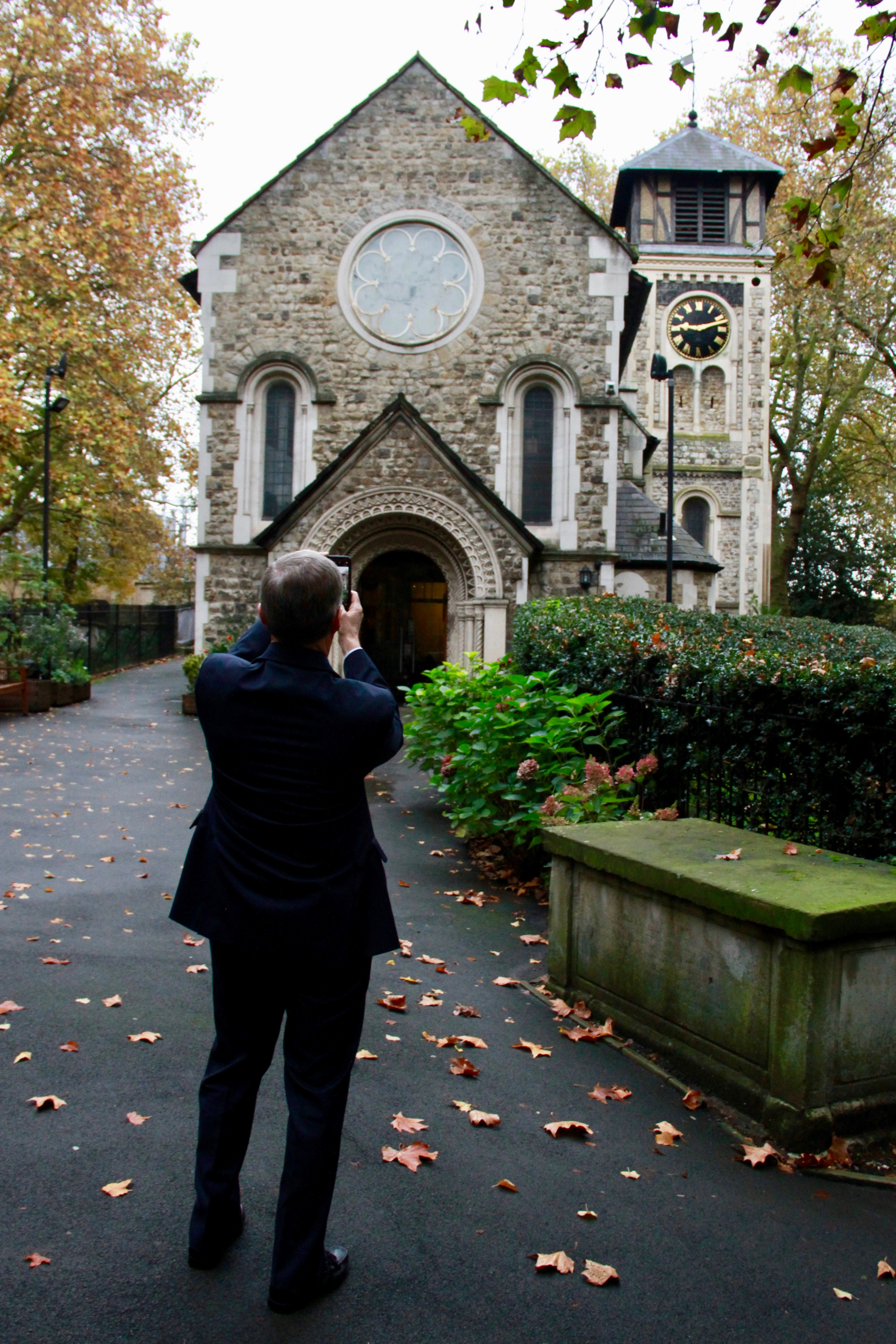 Elder David A. Bednar takes a photo of the outside of St. Pancras Old Church in London on Oct. 25, 2019. Elder Bednar's great-great-great-grandparents, Luke Syphus and Christiana Long, were married there on Dec. 25, 1851.
