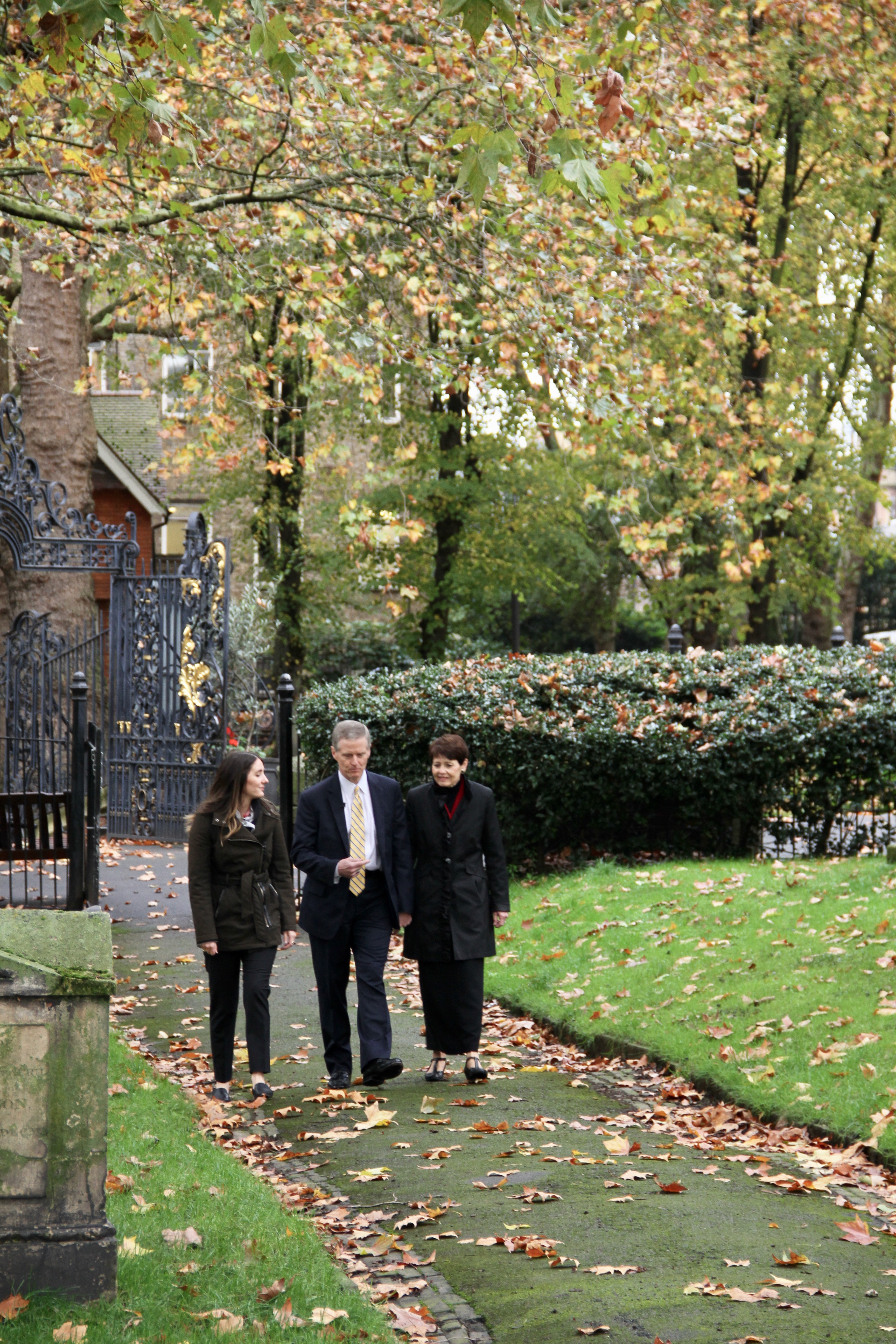 Whitney Peterson, a FamilySearch content strategist specializing in the British Isles, left, gives historical background about the St. Pancras Old Church to Elder David A. Bednar and his wife, Sister Susan Bednar, on Oct. 25, 2019, in London.