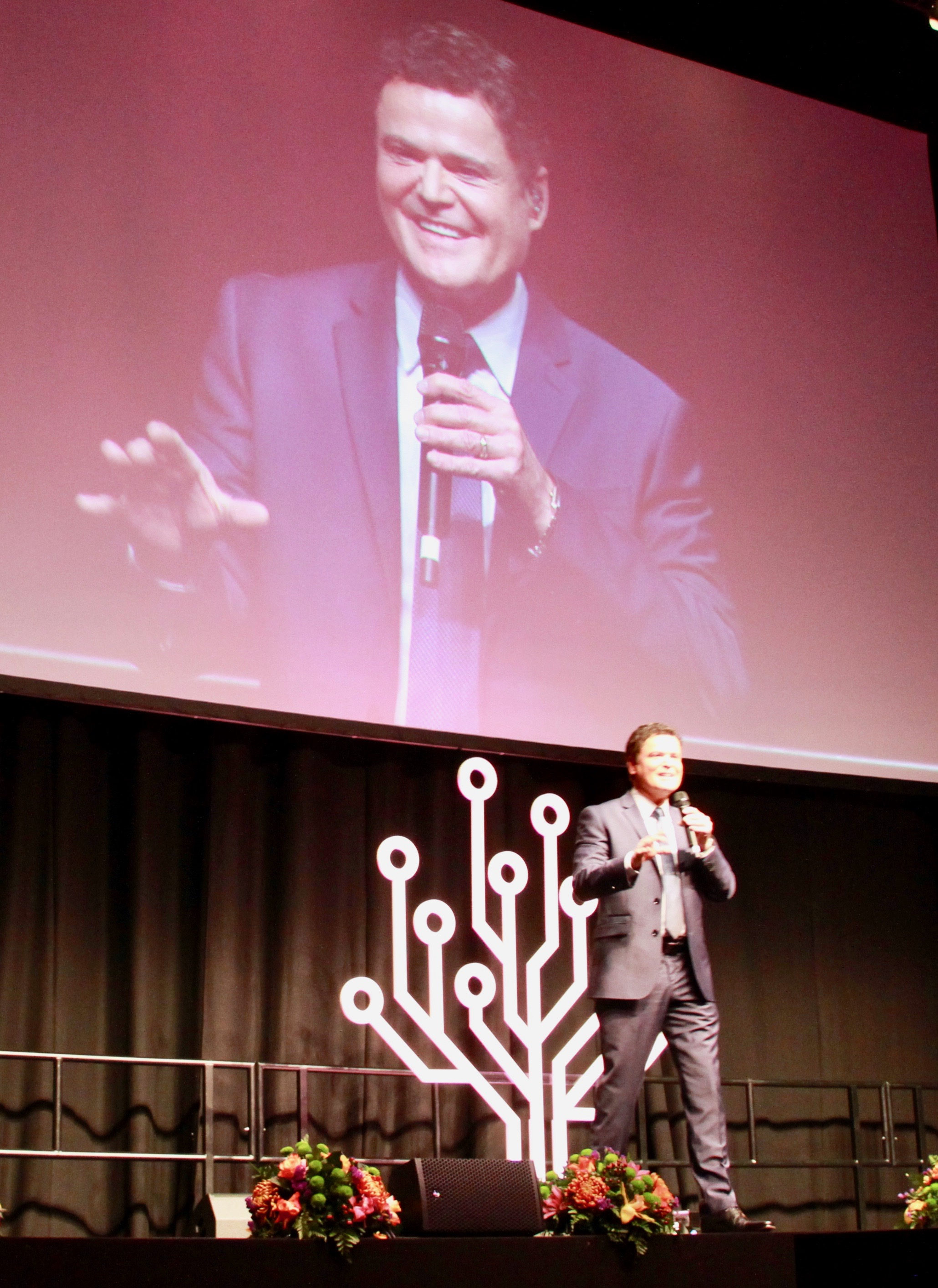 Donny Osmond entrains the London ExCel auditorium crowd during London RootsTech on Saturday, Oct. 26, 2019.
